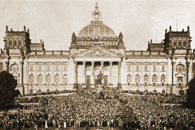 A mass demonstration in front of the German Reichstag against terms of the Treaty of Versailles.