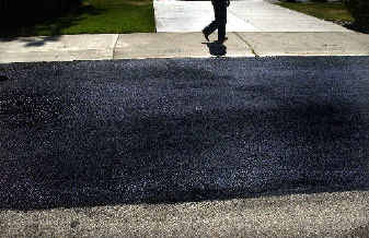 Low-cost slurry coating gives residential streets a second