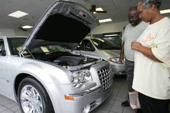 Arthur And Earlene Kimble Look At A 2005 Chrysler 300 On The Showroom Floor  At River