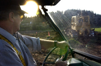 ray laboure checks out the work being done by wittkopf landscaping on the 27 acre - Seecontainerhuser Wa