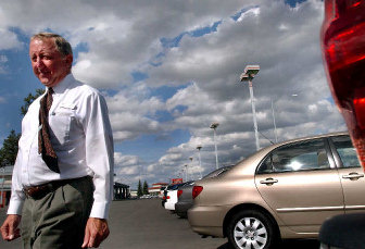 S Ociate Dave Liggett Walks Out To The Used Car Section On Lot Of Parker