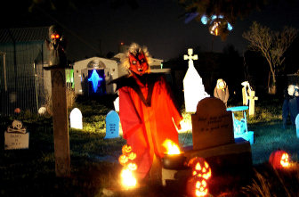 wilsons yard is transformed into a graveyard complete with monsters ghosts and ghouls on