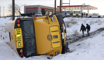 School bus overturns with 20 students aboard | The Spokesman-Review