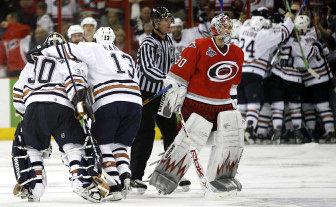 Carolina Hurricanes goaltender Cam Ward skates off the ice as the Edmonton  Oilers celebrate the game 5b4eabf5e