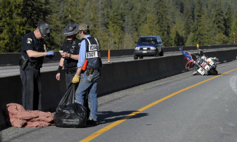 Idaho State Police Trooper Chuck Robnett Left Helps Another And Volunteer Bill