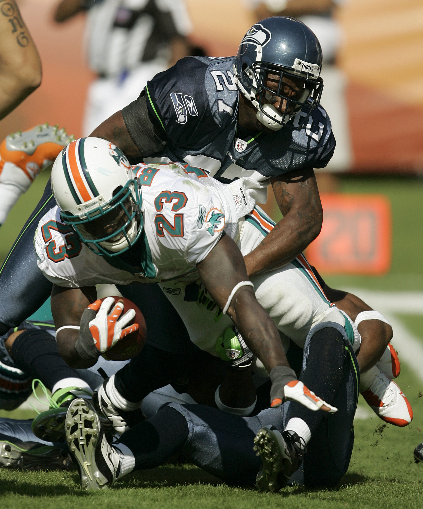 Dolphins Running Back Ronnie Brown 23 Is Taken Down By The Seahawks Jordan