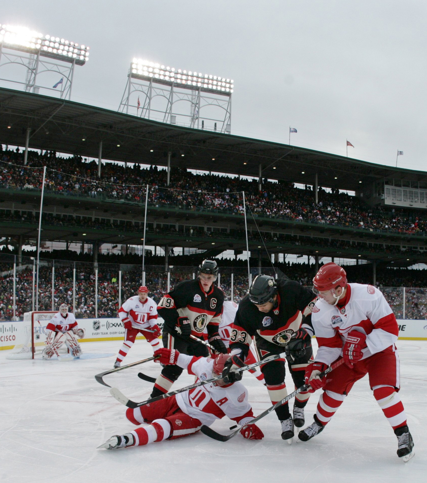 Detriot and Chicago players battle for the puck during the third period of  the NHL Winter 8ff5ea448