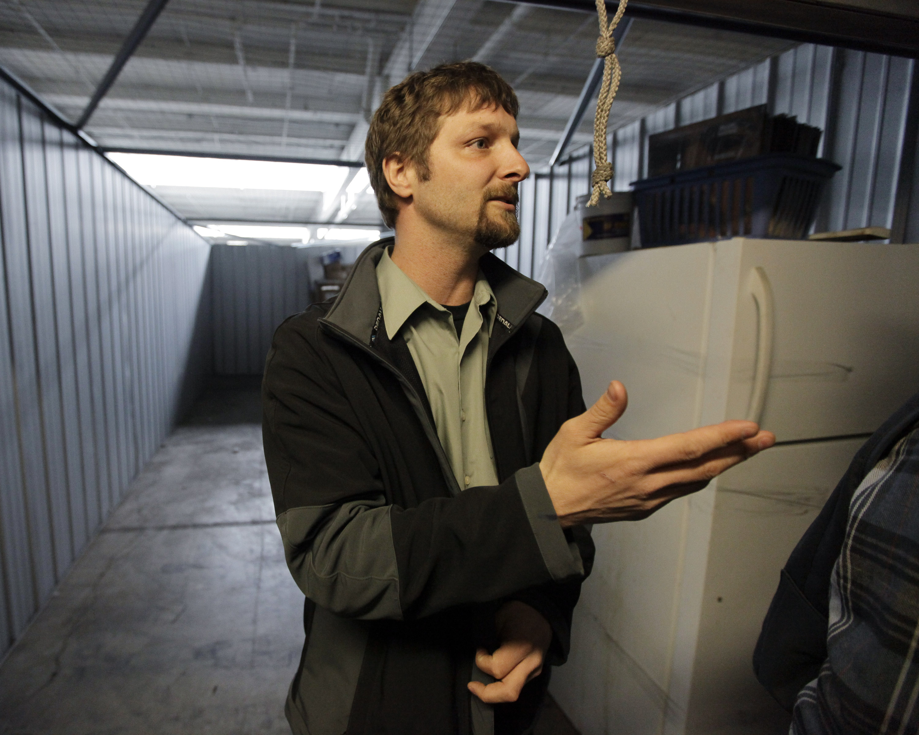 Brook Snyder auctions off property from a locker inside a storage facility in Chicago. The  sc 1 st  The Spokesman-Review & Bidders haul in bounty at storage-unit auctions | The Spokesman-Review