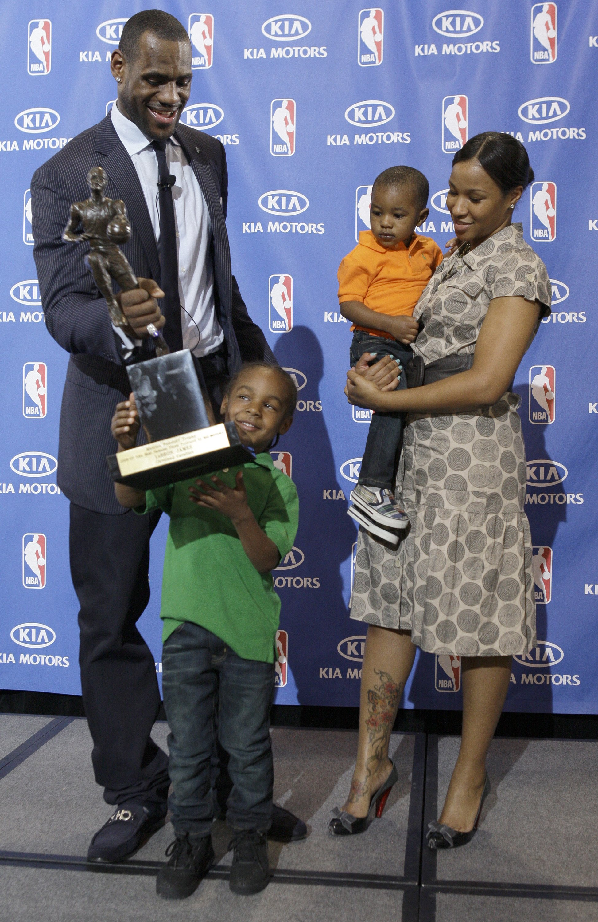 ea760c141caa Cavaliers LeBron James hands the MVP trophy to his son Lebron Jr.