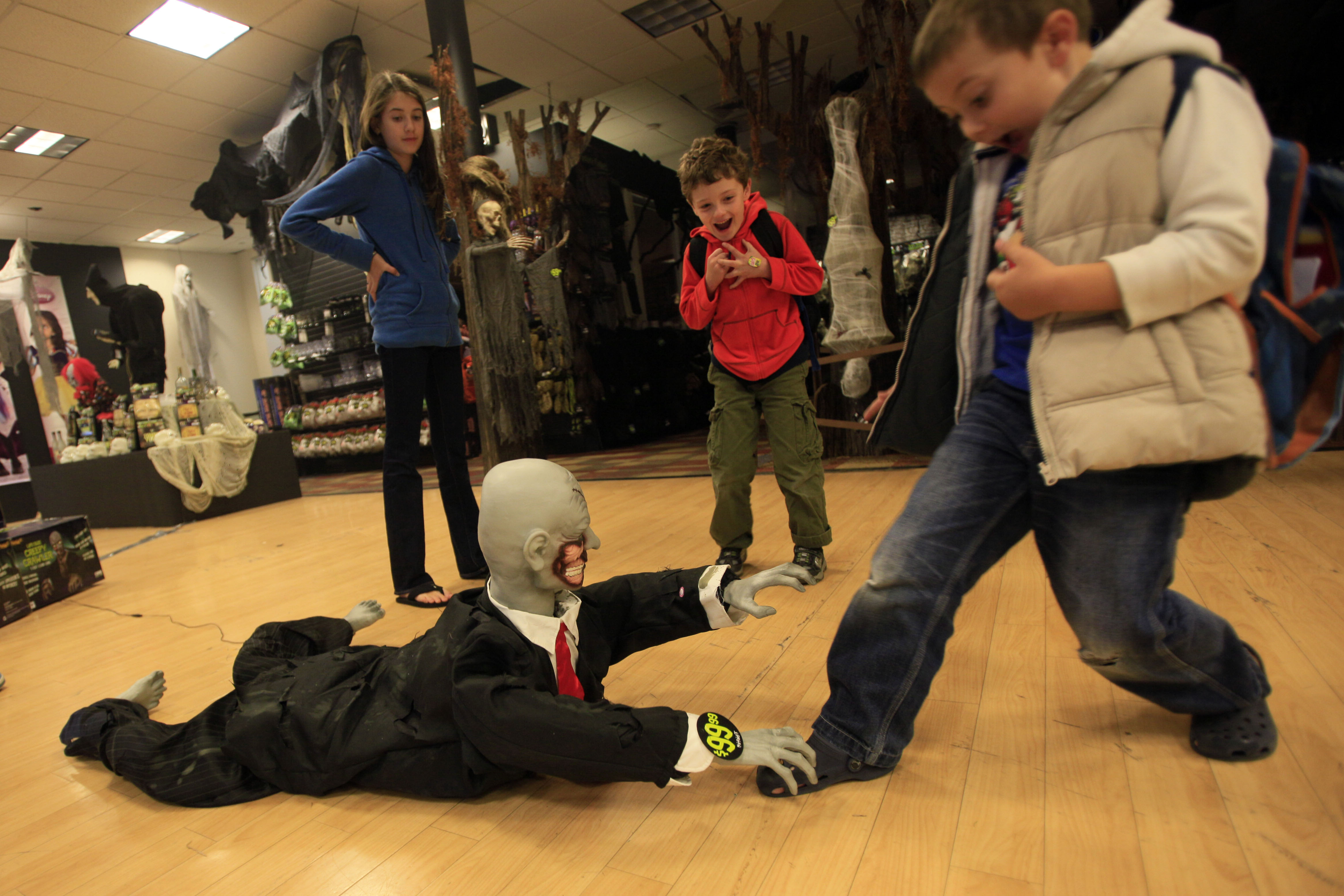 children play with the halloween display at the spirit halloween store in new york the