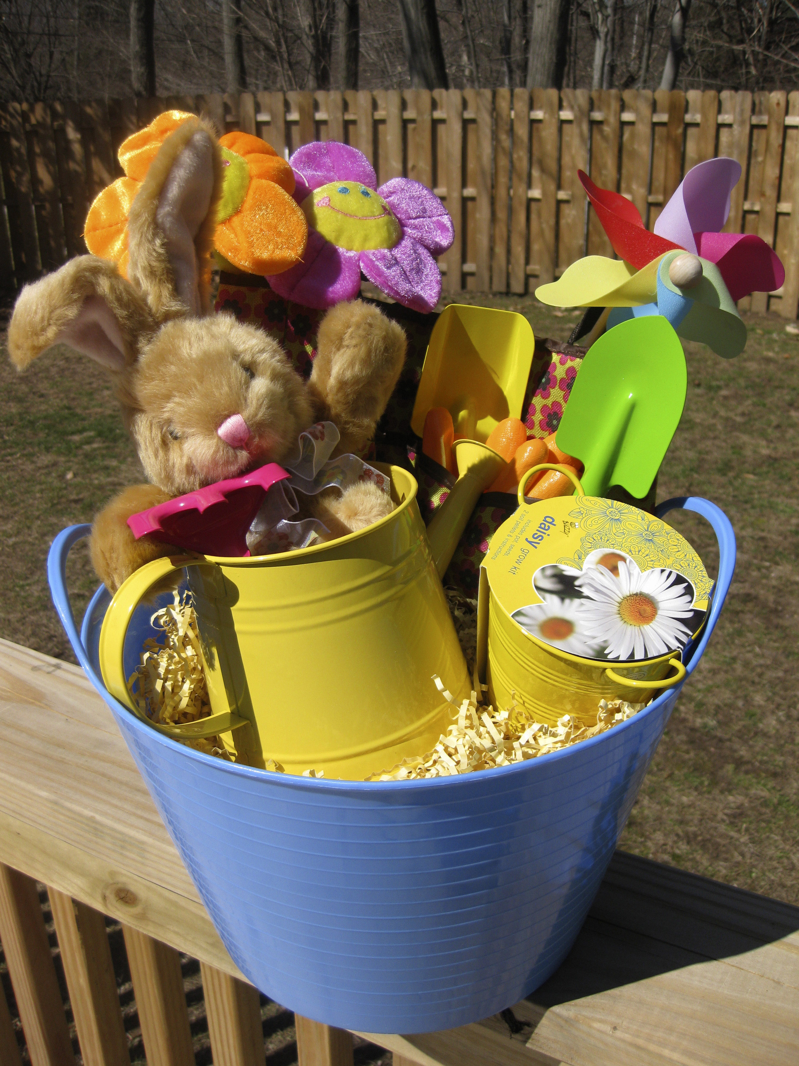 Baskets without candy still fun the spokesman review one easter basket option includes a small plastic bucket holding a watering can daisy grow negle Choice Image