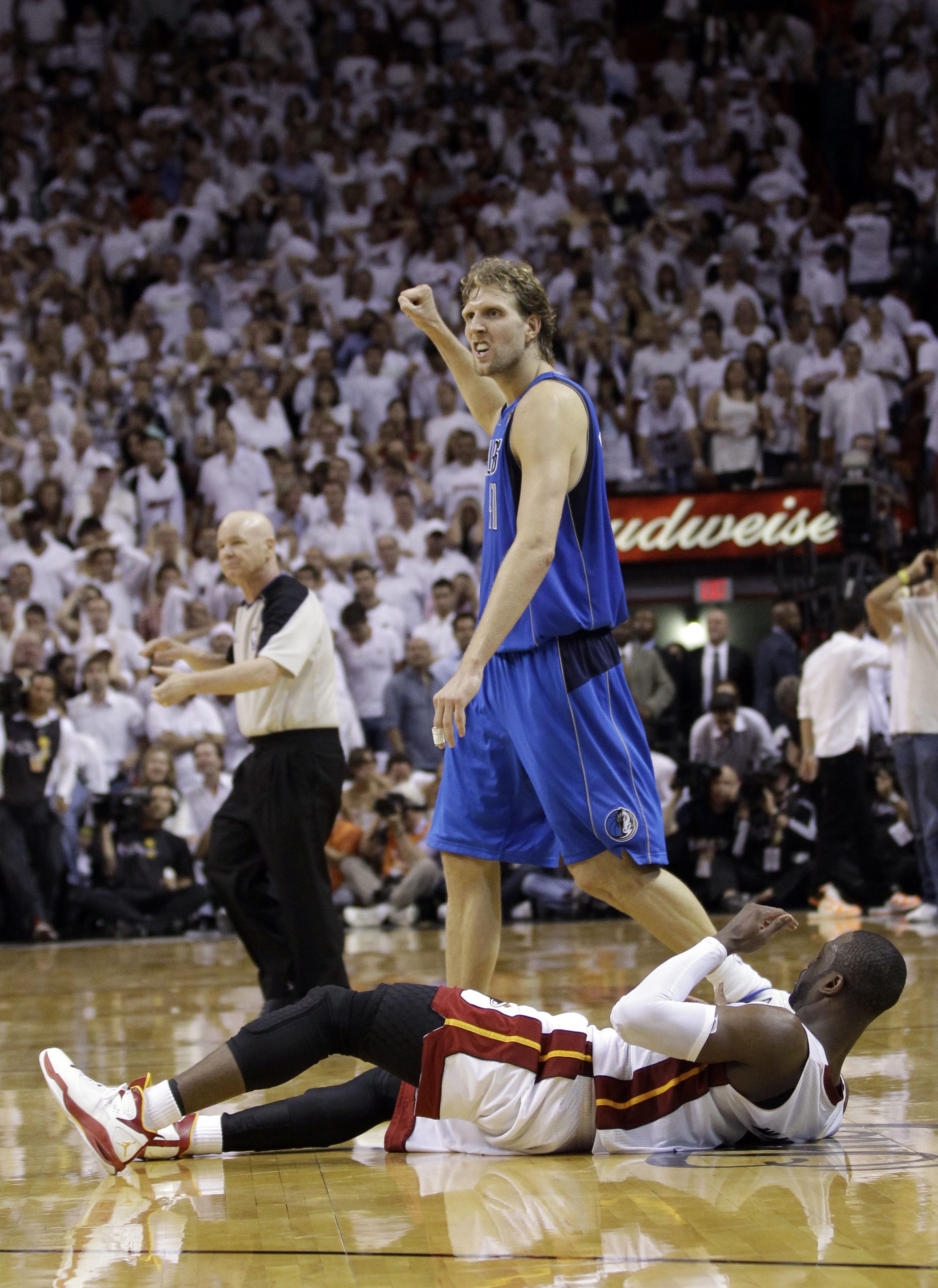 601e25221 Mavericks  Dirk Nowitzki pumps his fist over Miami Heat s Dwyane Wade as  Dallas ties finals