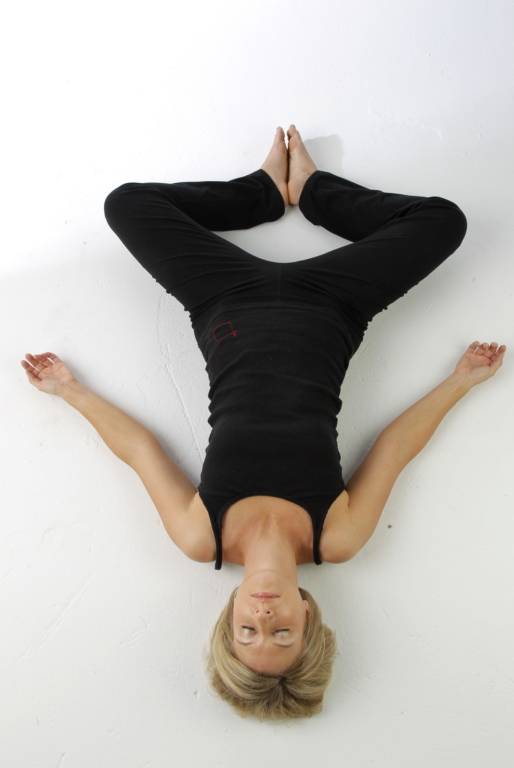 Meredith Smith Demonstrates The Yoga Pose Reclining Butterfly