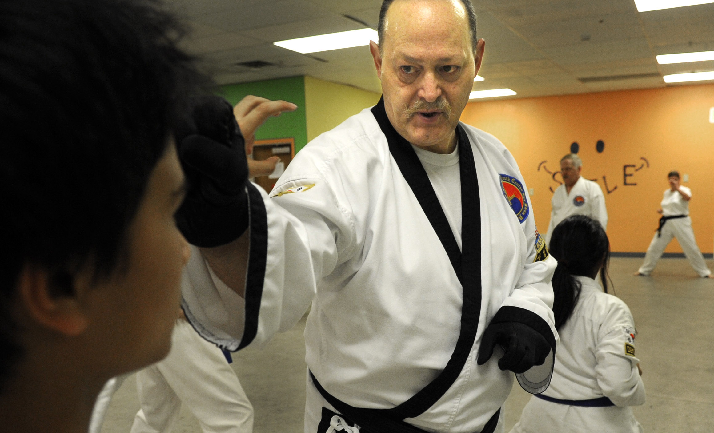 Students pay for taekwondo lessons with monthly food
