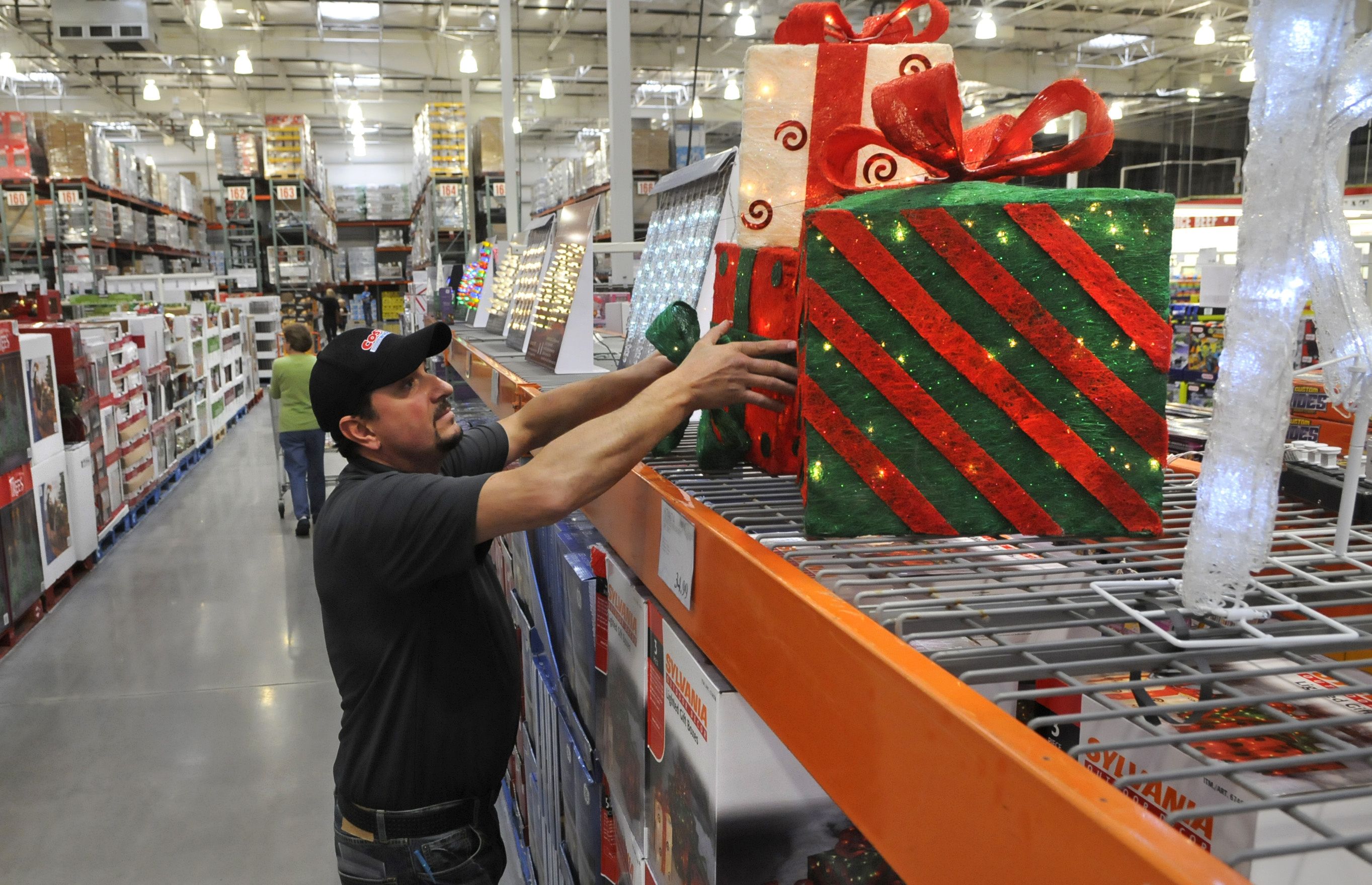mike davis store stocker straightens merchandise along the holiday aisle at the sprague avenue