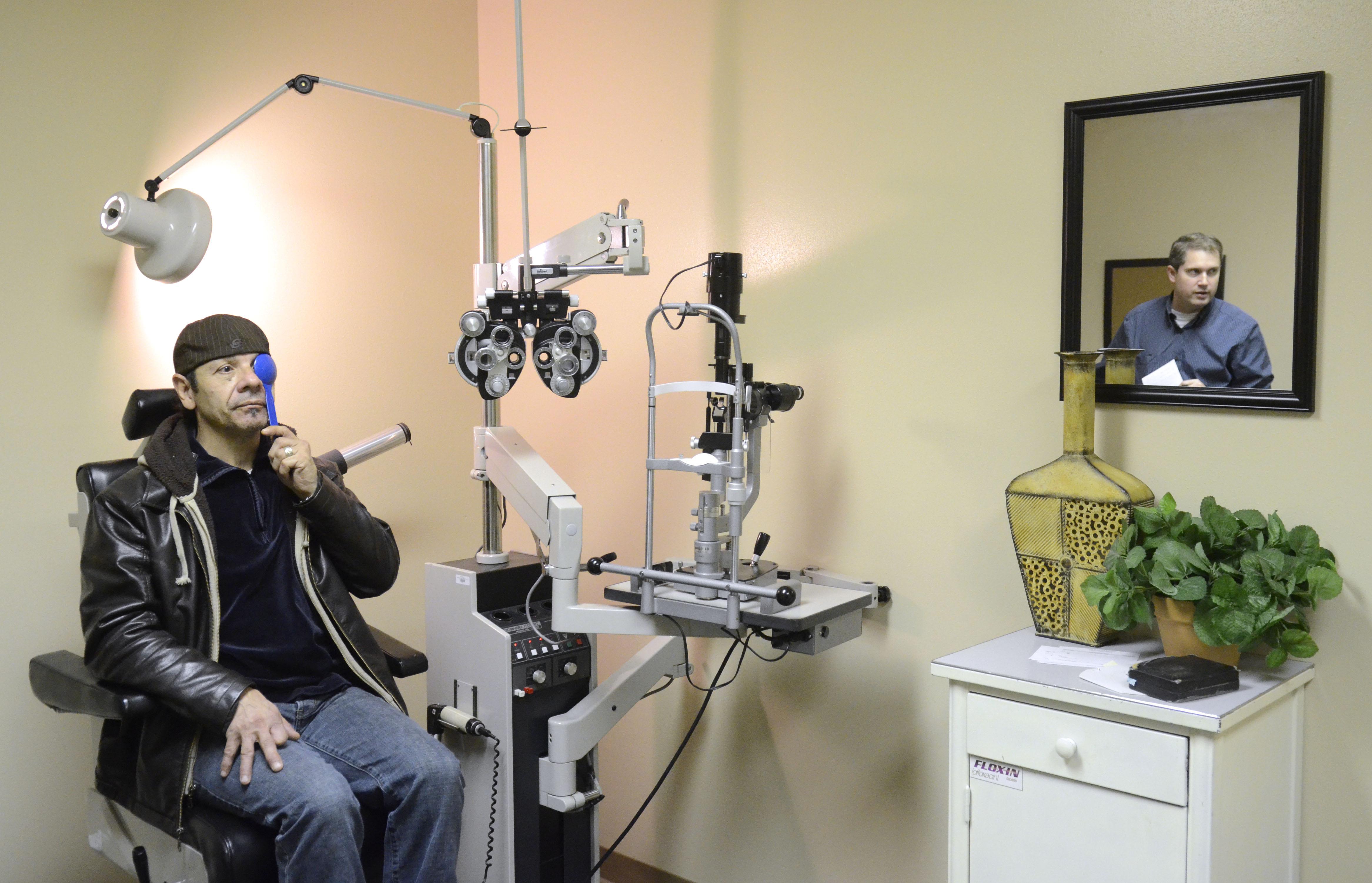 dd7e4d7b732a Chet Holmquist gets an eye exam from optometrist Mitch Maier