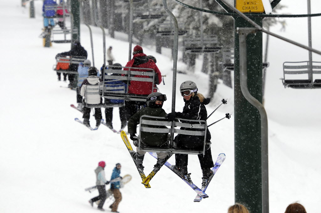 Skiers Take The Chair Lift Up The Hill For Another Run On Mt. Spokane.