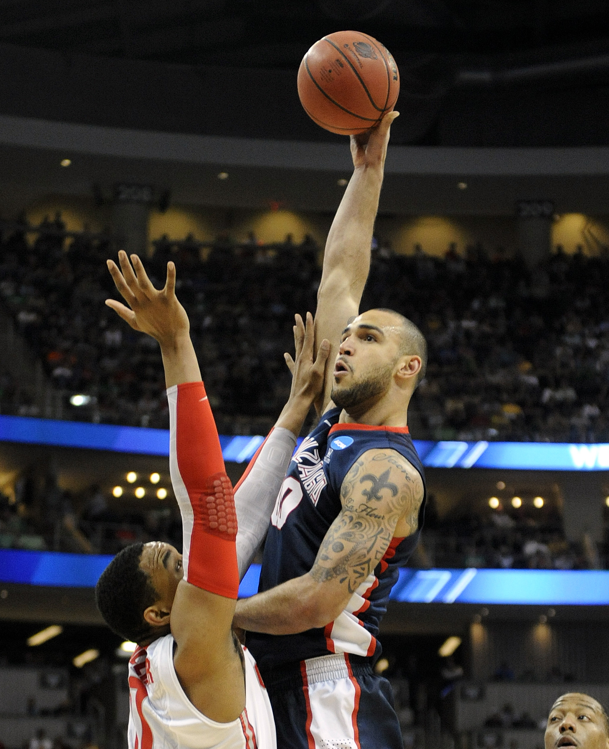 e01655fe7 Gonzaga s Robert Sacre shoots a jump hook during the Bulldogs  loss to Ohio  State on