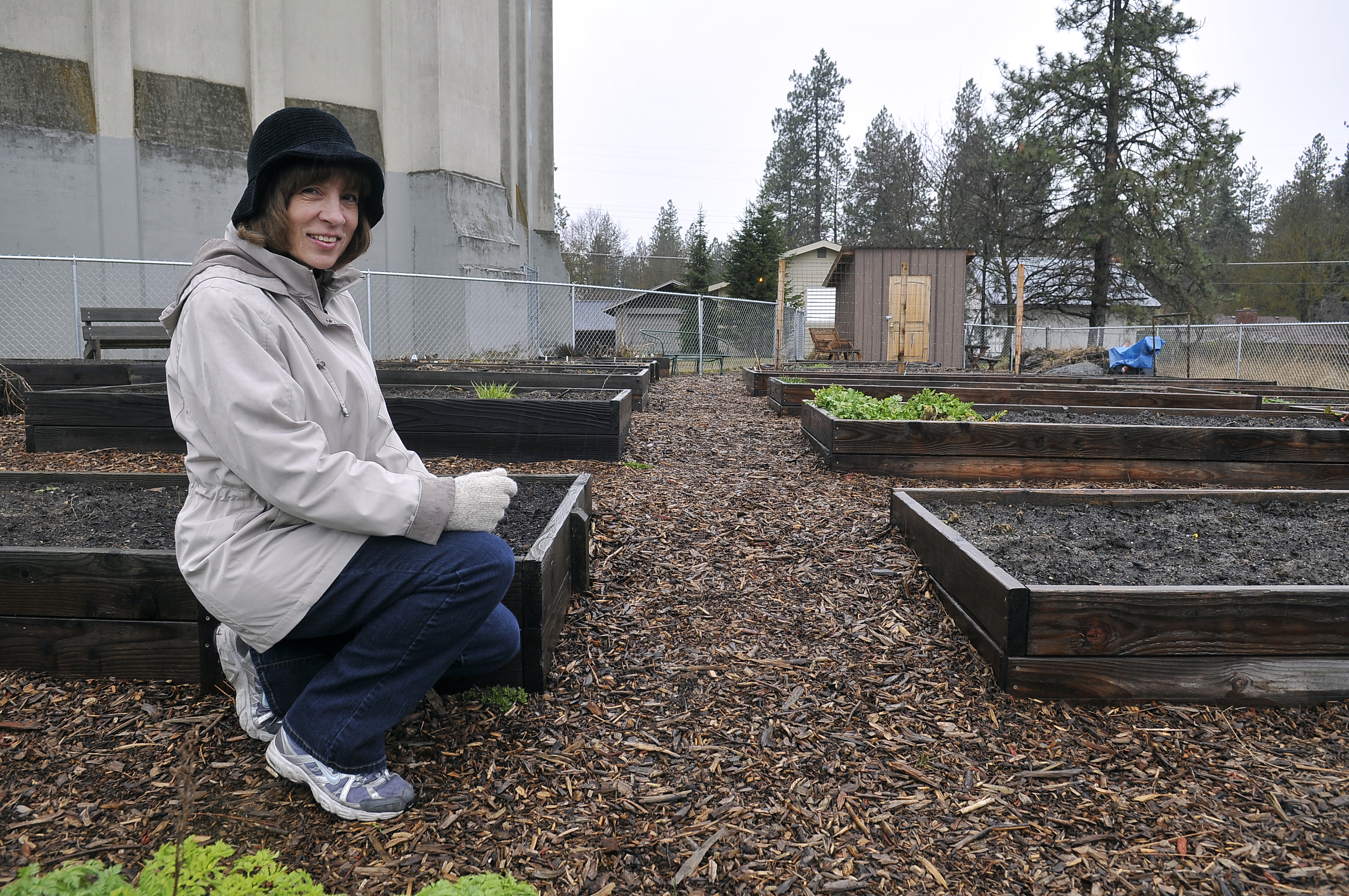 Lori Kinnear Stops For A Photo In The Community Garden On The West Side Of  Sacajawea