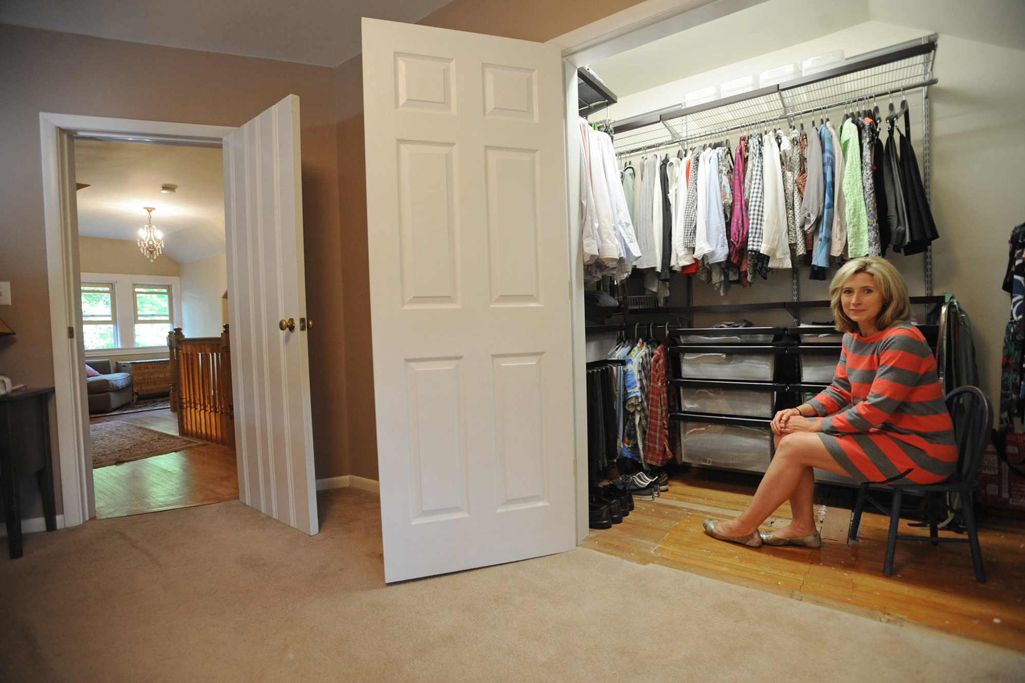 Jennifer Scherer Sits In Her New, Bigger Closet At Her Home In Paterson,  N.J.