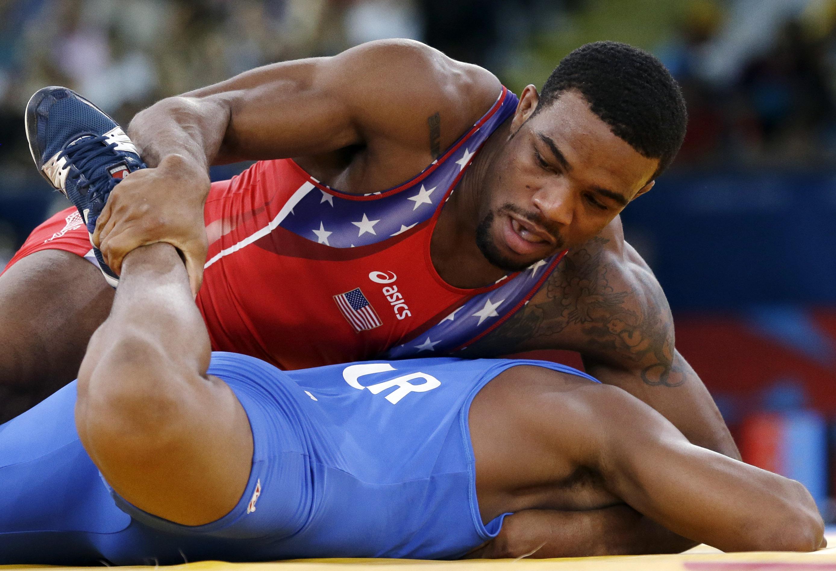 3e3de8170dd90a U.S. freestyle wrestler Jordan Burroughs controls Puerto Rico s Francisco  Daniel Soler Tanco during an early match