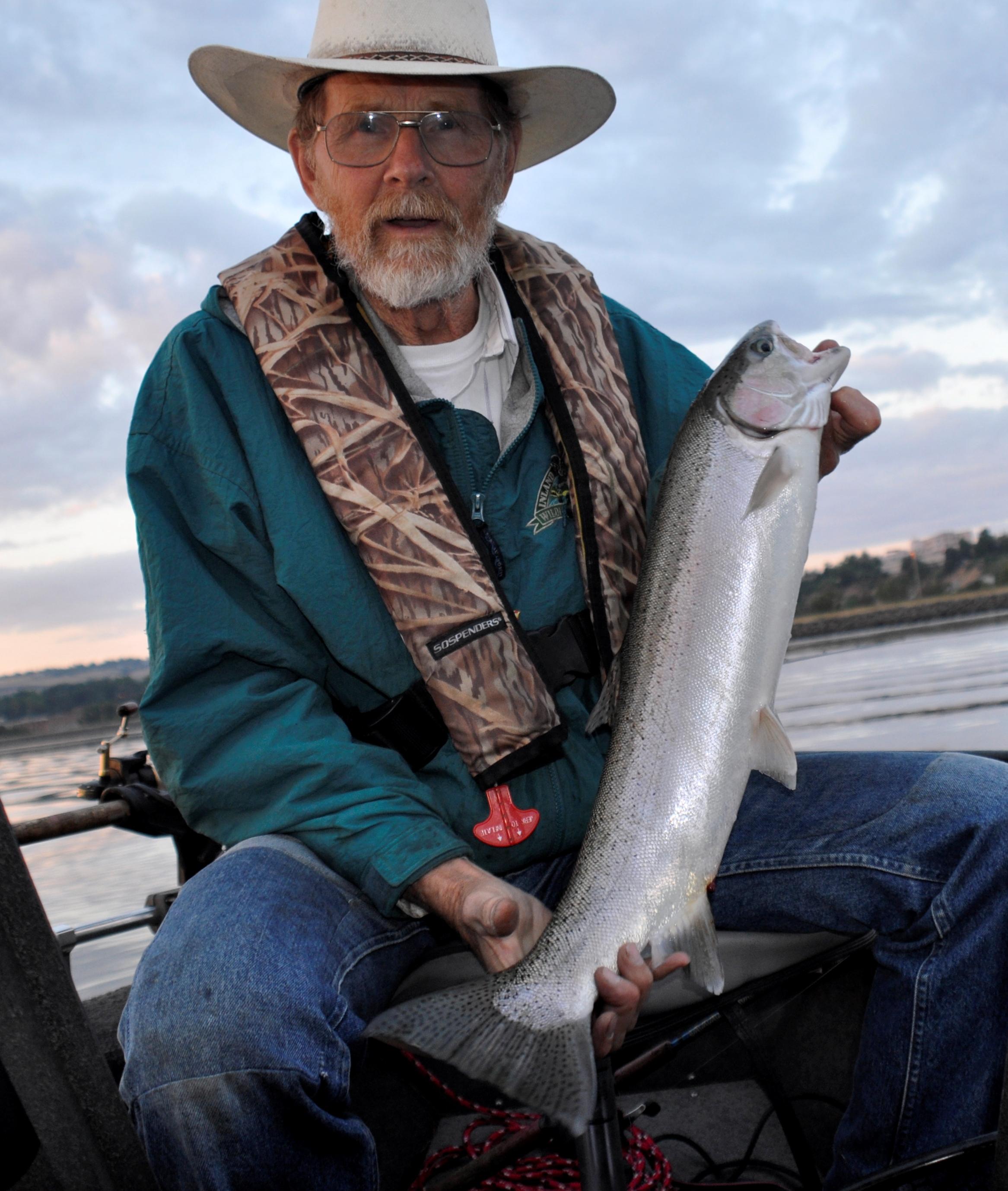 Jim Kujala hauls in a hatchery steelhead from the lower Clearwater River.  (Rich Landers 244900c94c