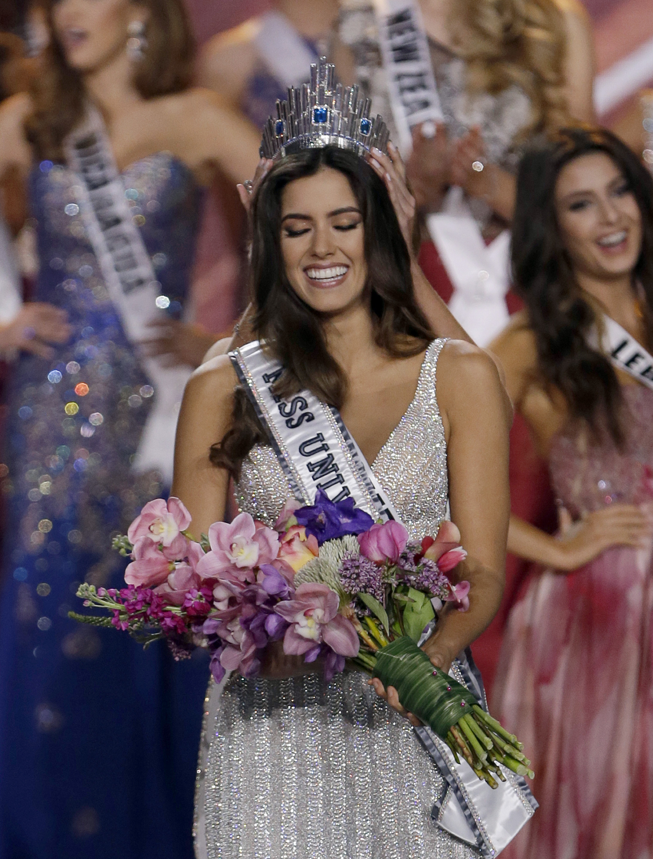 820fead03a Miss Colombia Paulina Vega smiles as the crown is placed on her head as she  becomes