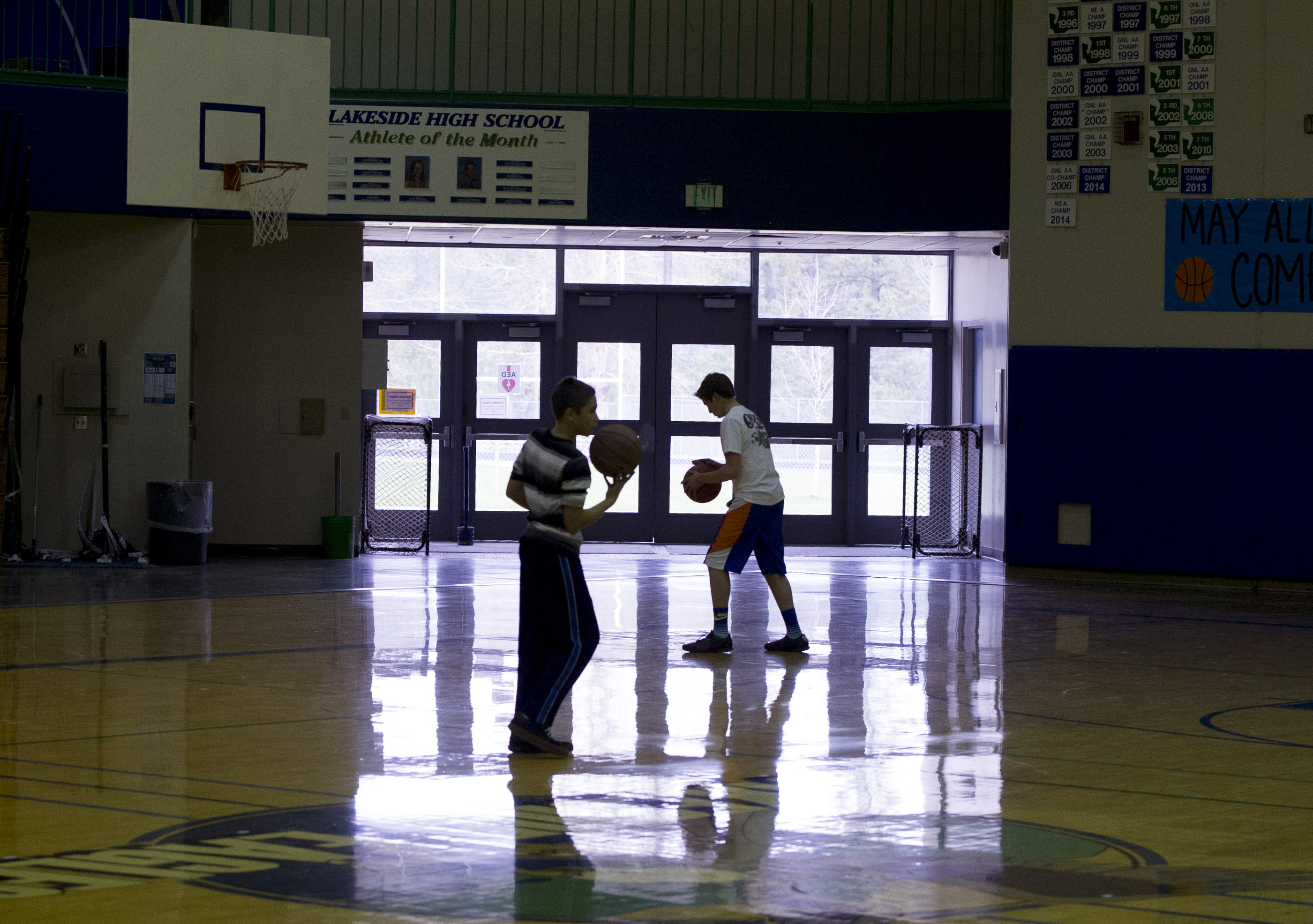 Lakeside Students Exercise During Gym Class In Front Of One Of Several Doors  Leading Into The