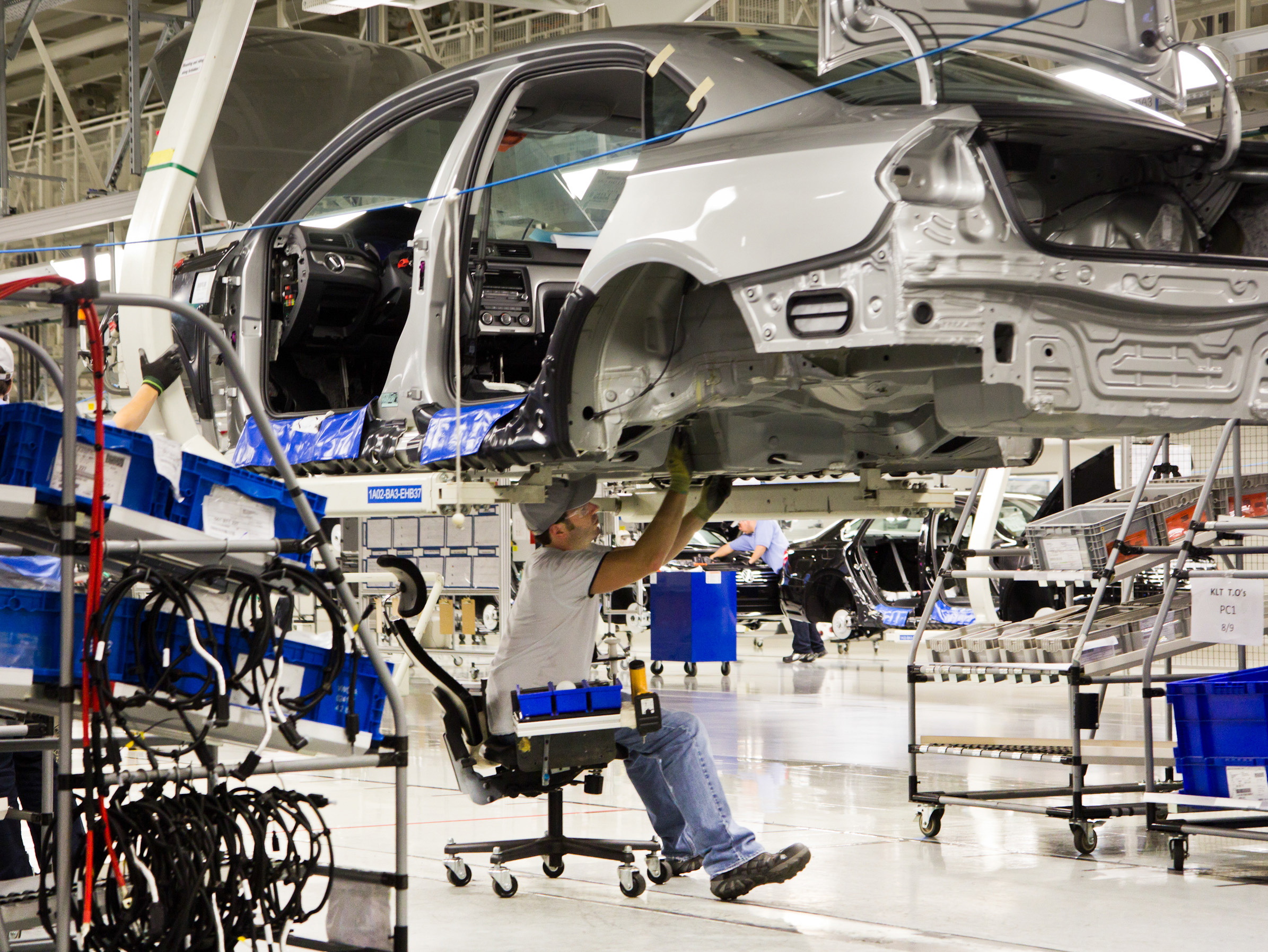 An Employee Works On A Pat Sedan At The Volkswagen Plant In Chattanooga Tenn