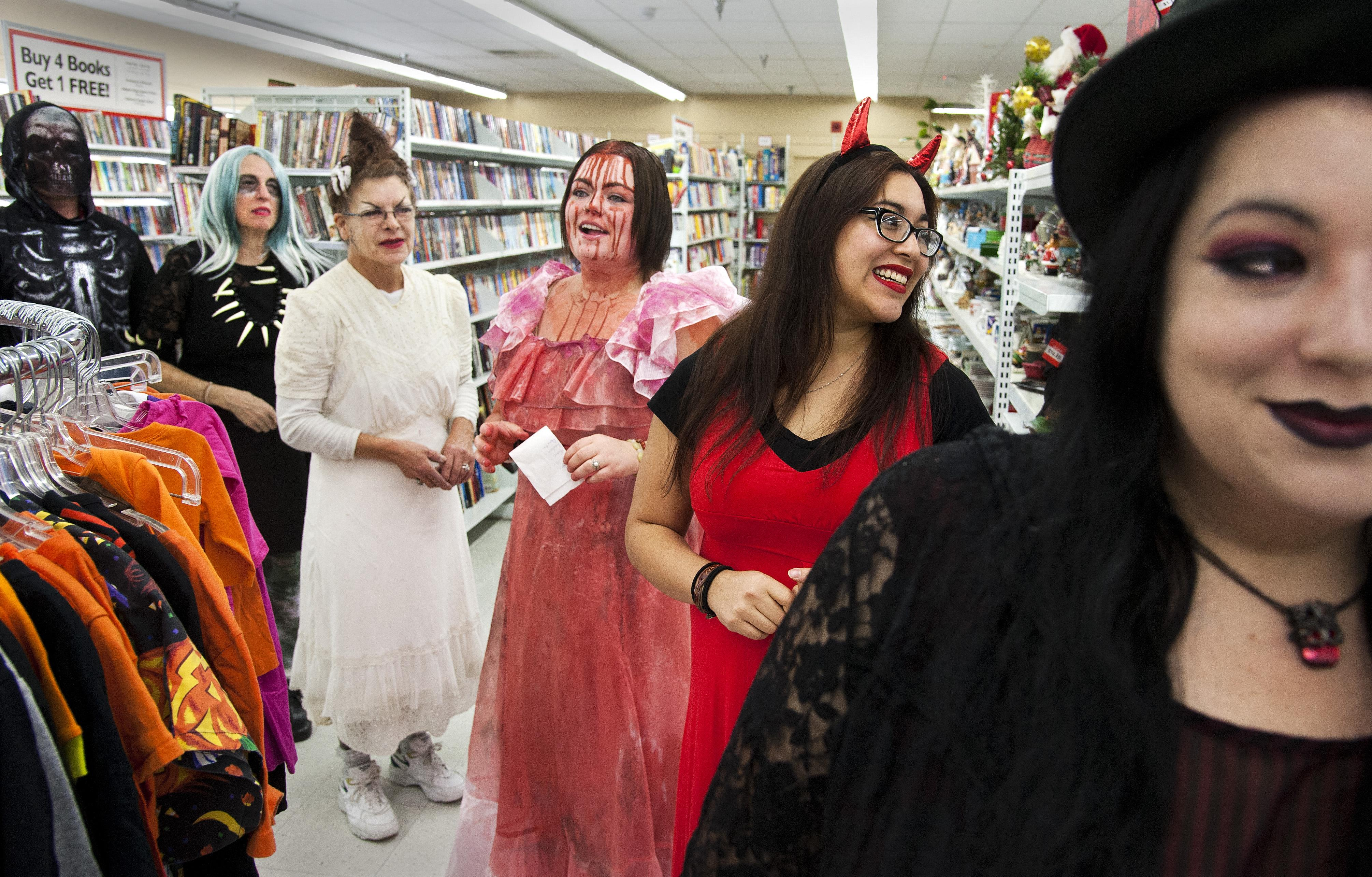 employees at value village on west boone avenue line up for the stores traditional halloween costume