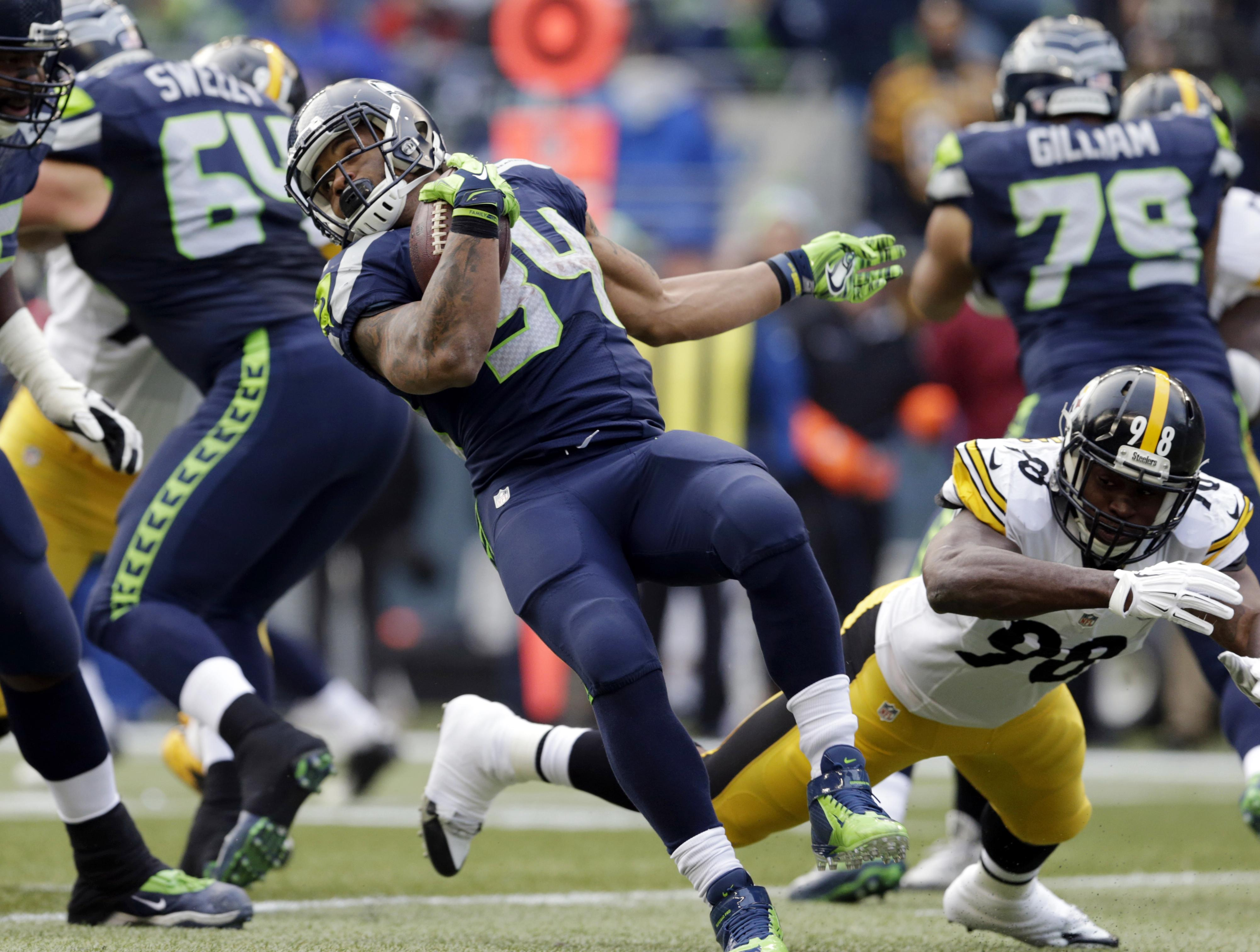 fc6a5cb3fd5 Seahawks' Thomas Rawls, left, rushes past Pittsburgh Steelers' Vince  Williams in the