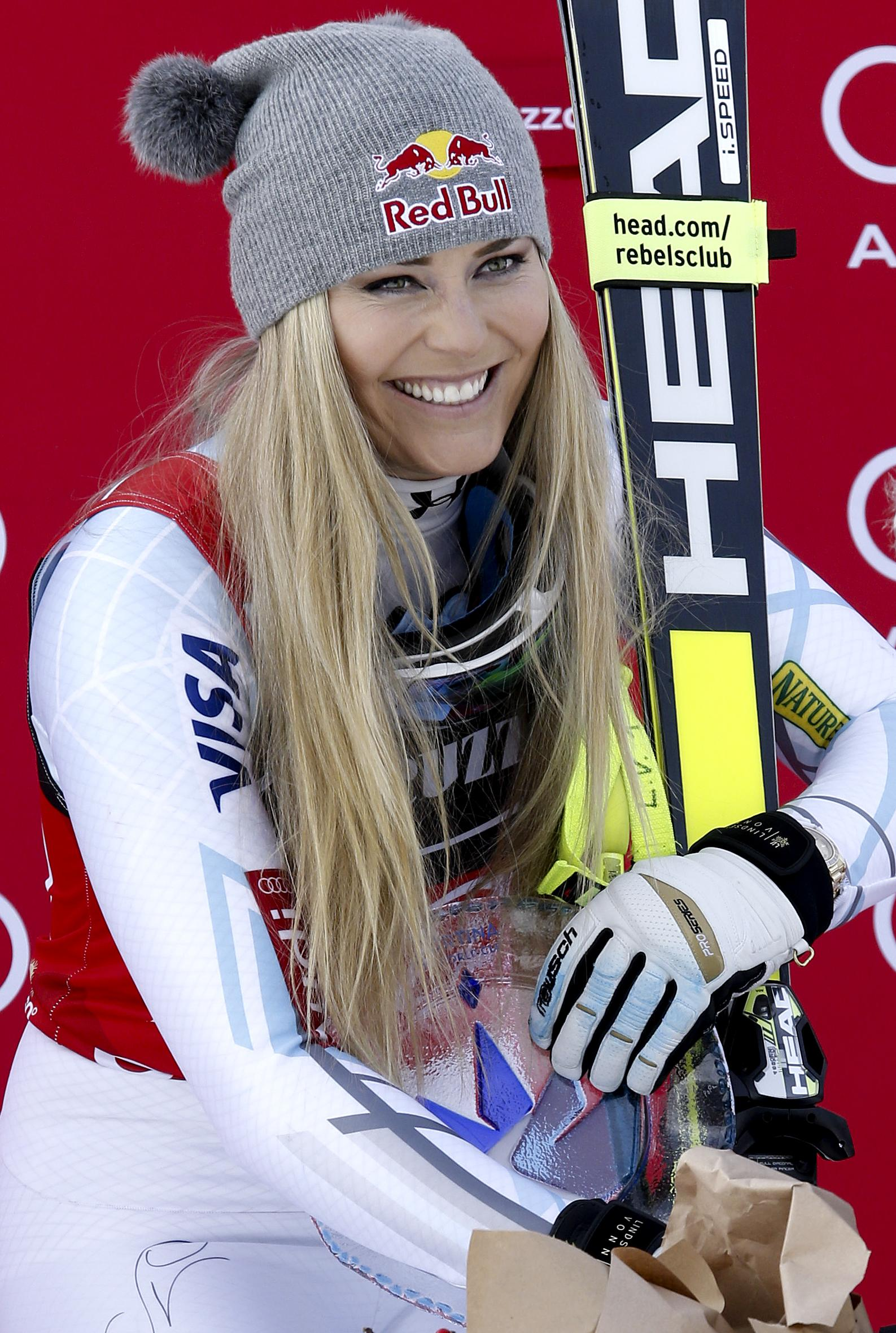 Lindsey vonn smiles during the podium ceremony after winning the women