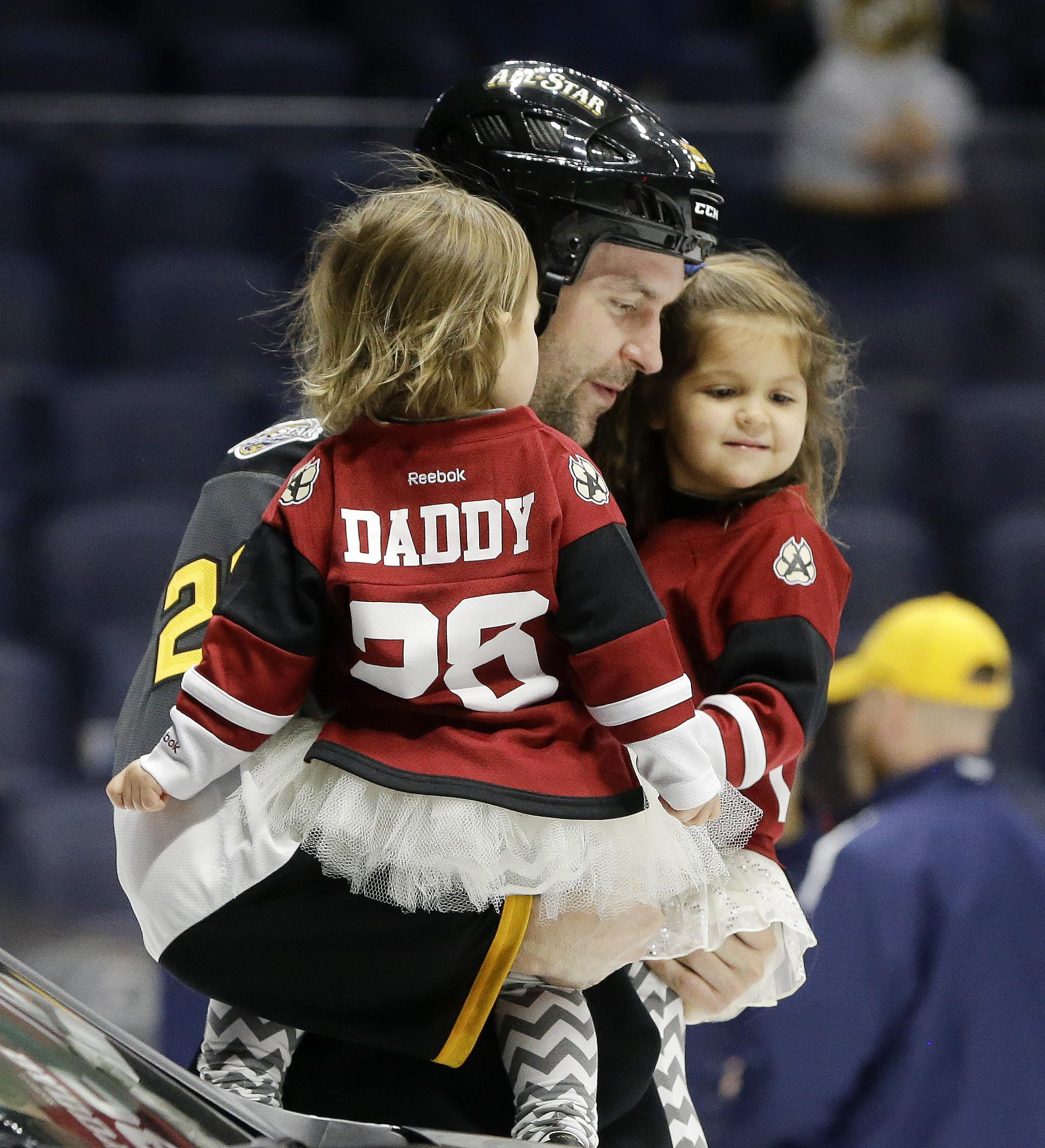82aa9f01e Pacific Division forward John Scott carries his children onto the ice after  being named the most