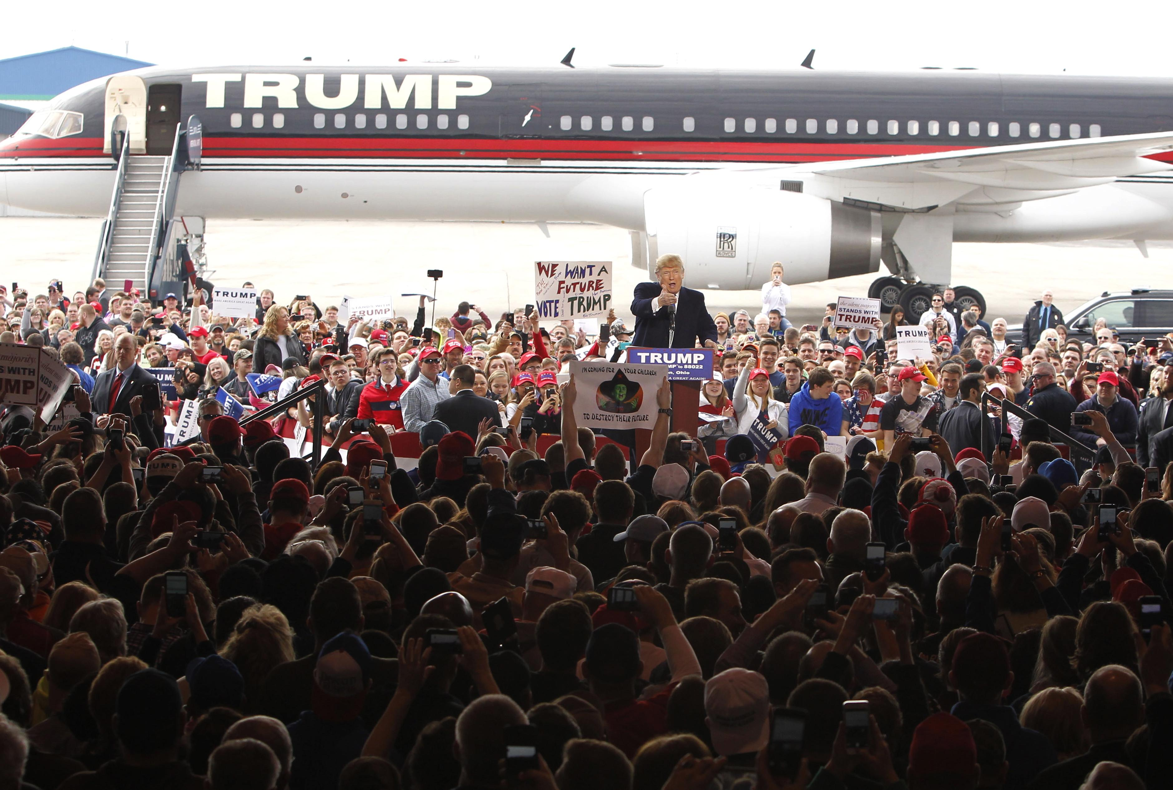 Gop rivals question whether theyd back trump as nominee the republican presidential candidate donald trump arrives at the wright brothers aero hangar for a rally publicscrutiny Image collections
