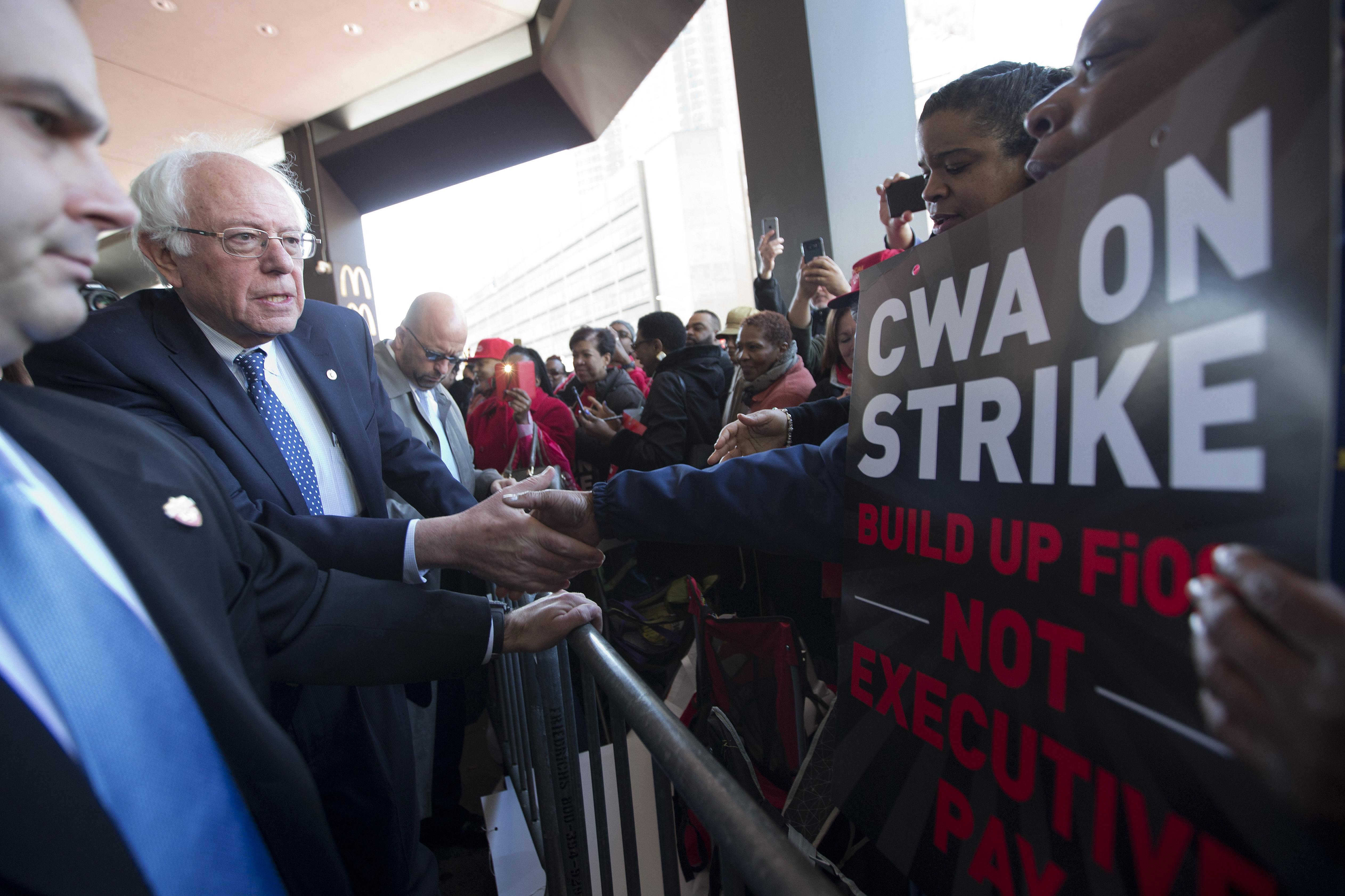 bernie sanders joins striking workers at verizon office the