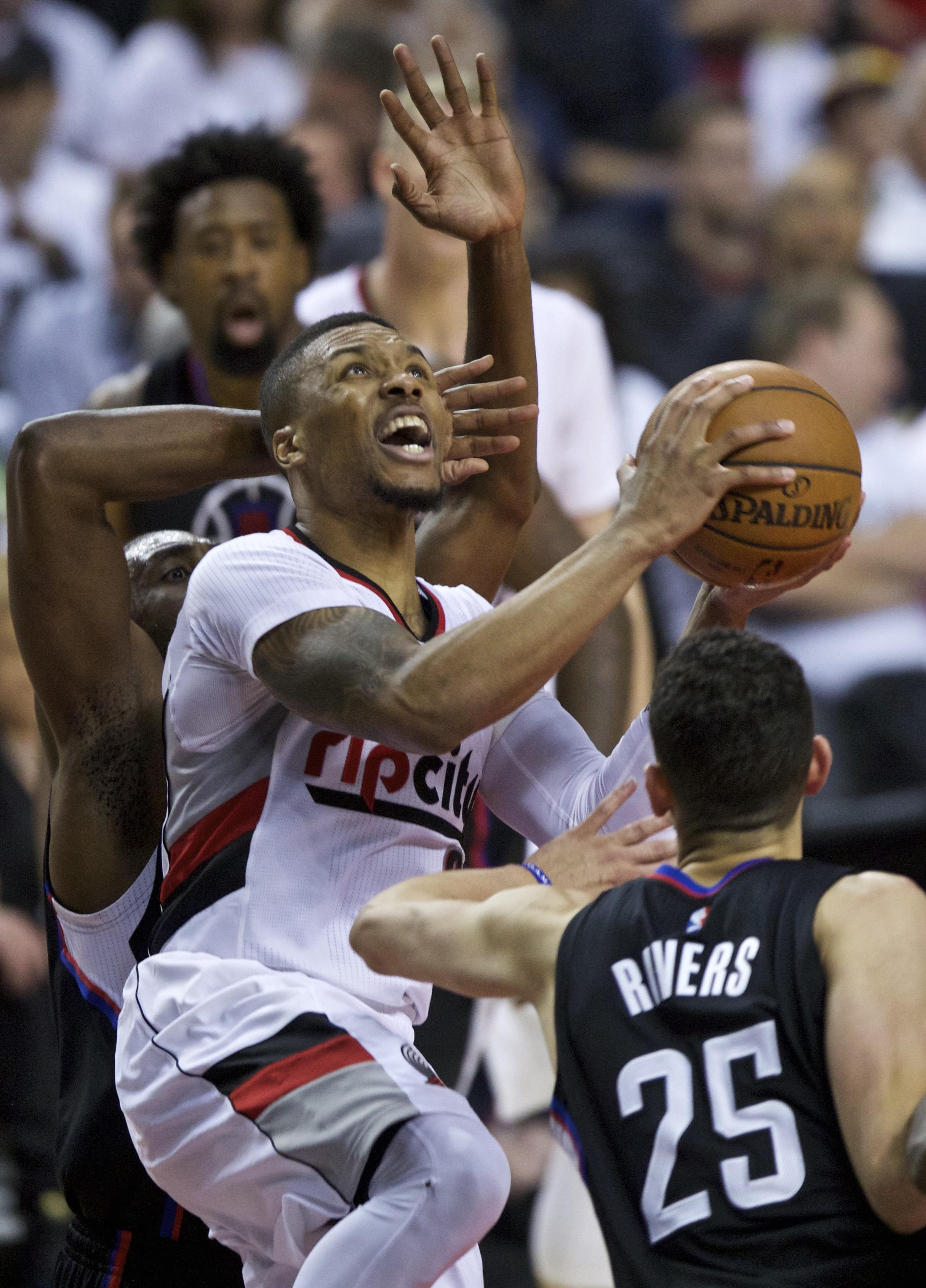 0f8c928418a Trail Blazers' Damian Lillard shoots in front of Clippers'Austin Rivers,  right,