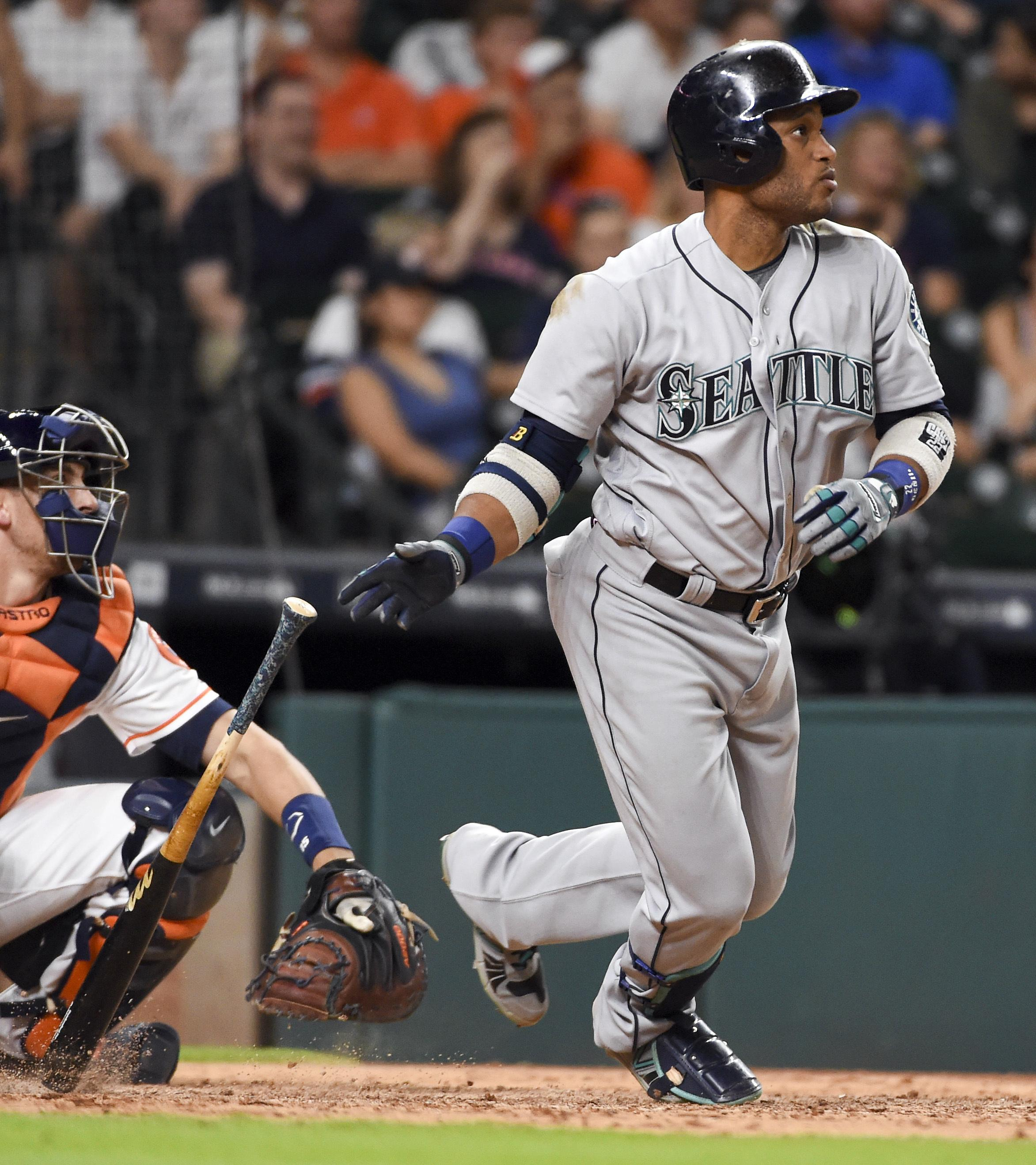 79b65ab3d Seattle s Robinson Cano watches his three-run double in the ninth inning  Thursday against Houston