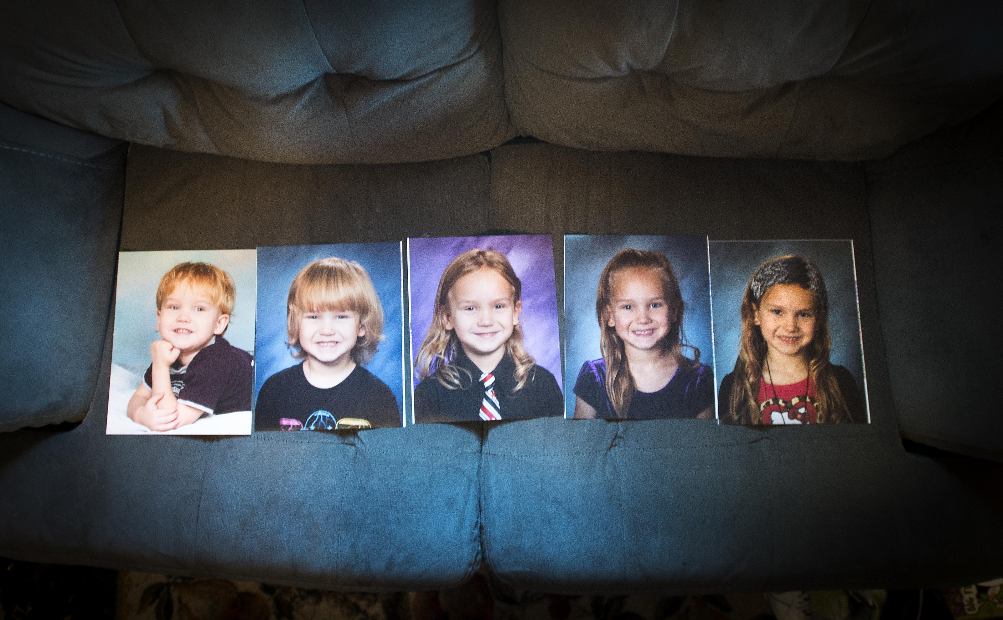 Photos of Rachel White, ranging from age 3-7, show her transition from a boy named Trey to the second grade girl she is today. (Colin Mulvany / The Spokesman-Review)