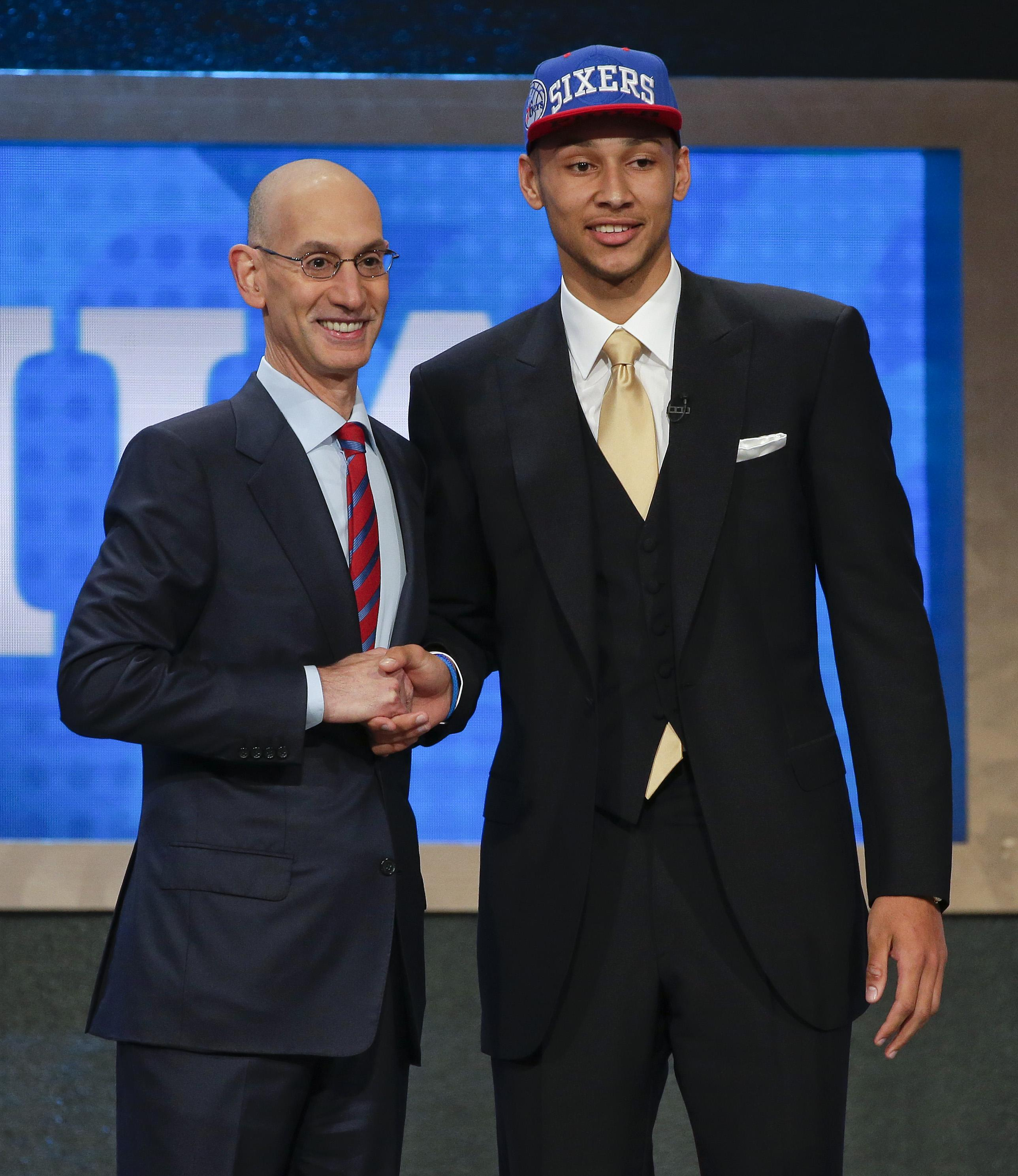 6ac3bf400961 LSU s Ben Simmons poses with NBA commissioner Adam Silver after being  selected as the top pick