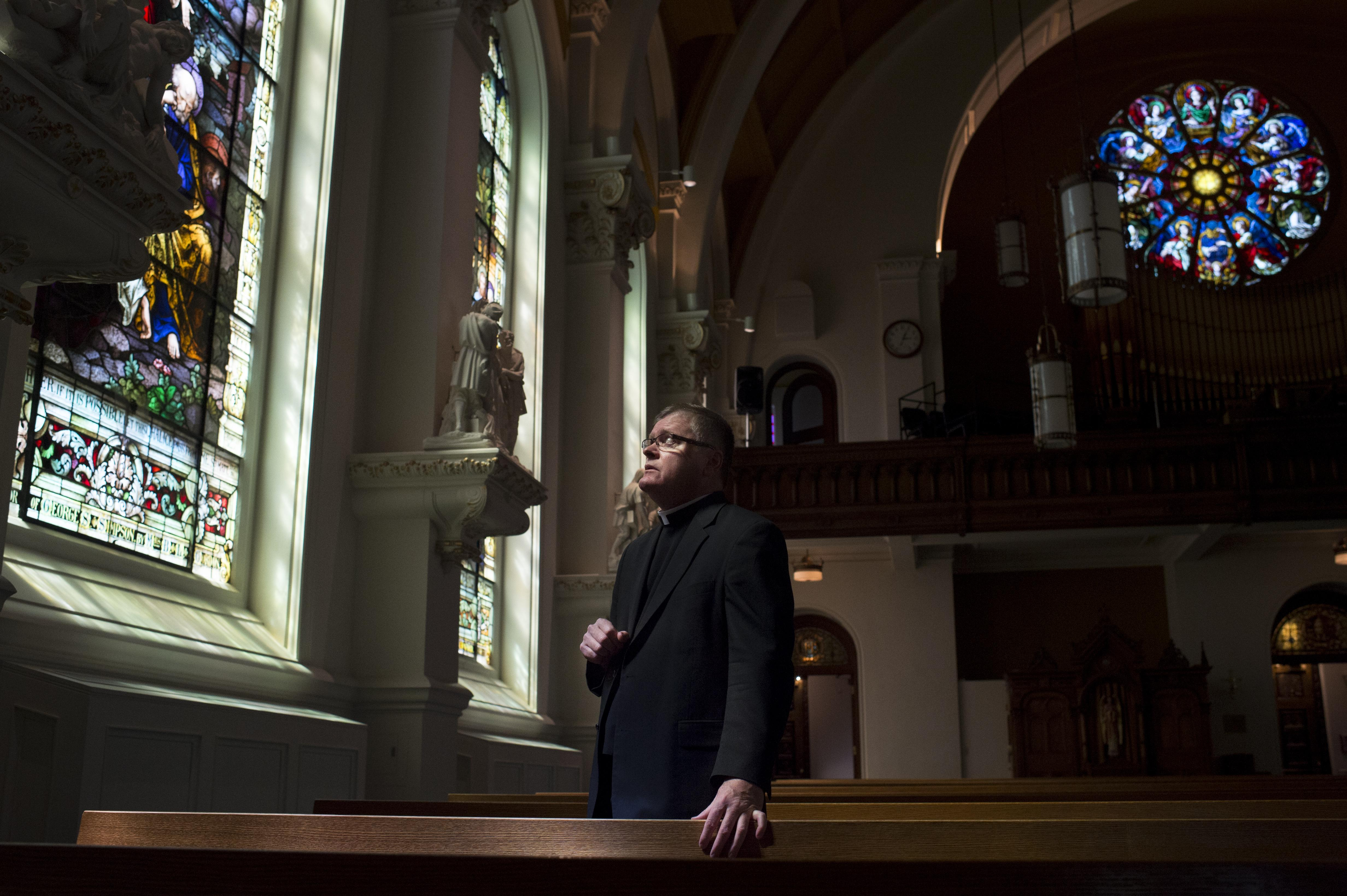 The Rev. Darrin Connall Stands In The Cathedral Of Our Lady Of Lourdes On  Tuesday