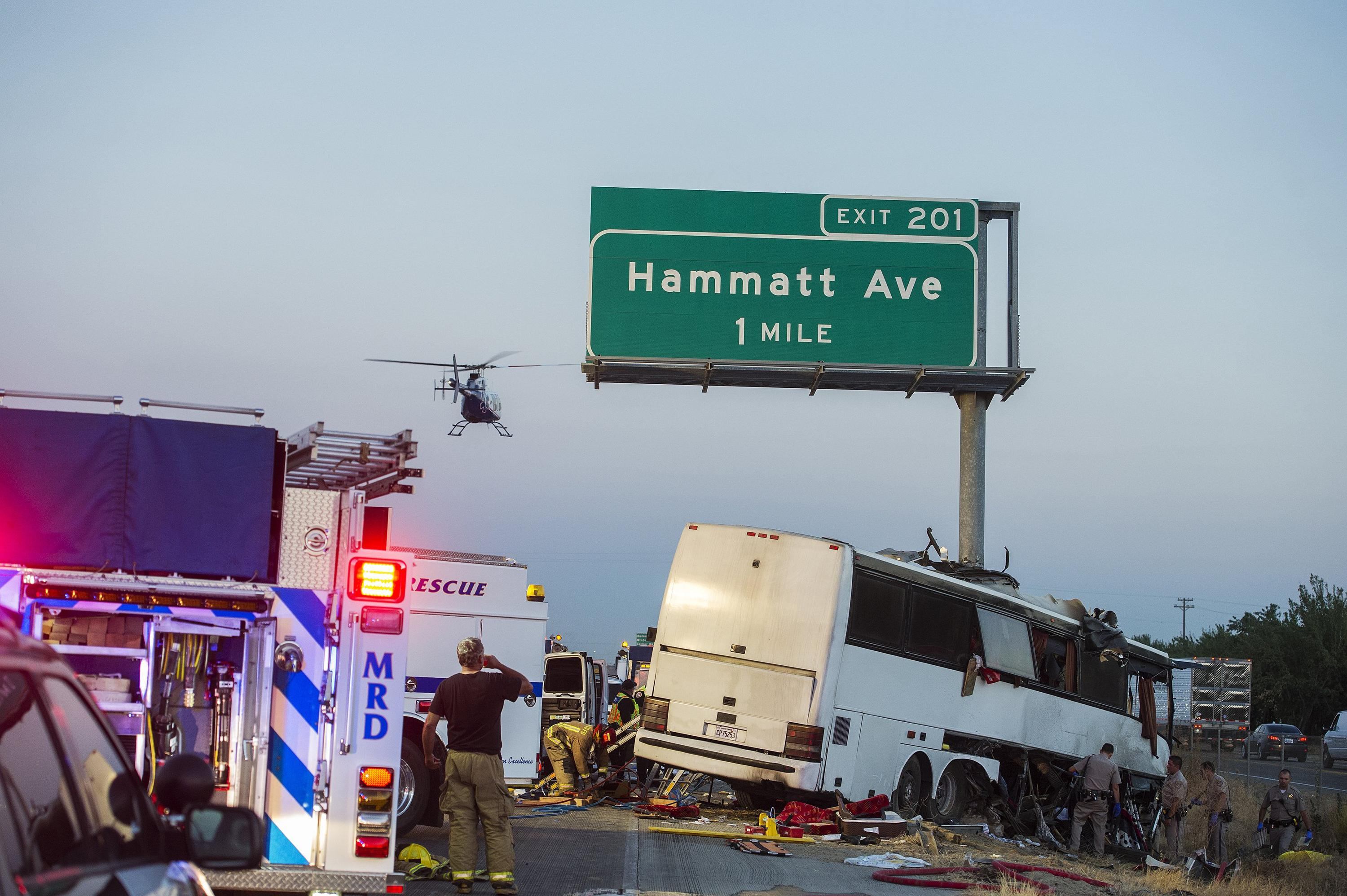 Rescue Crews Respond To The Scene Of A Charter Bus Crash On Northbound Highway 99 Between