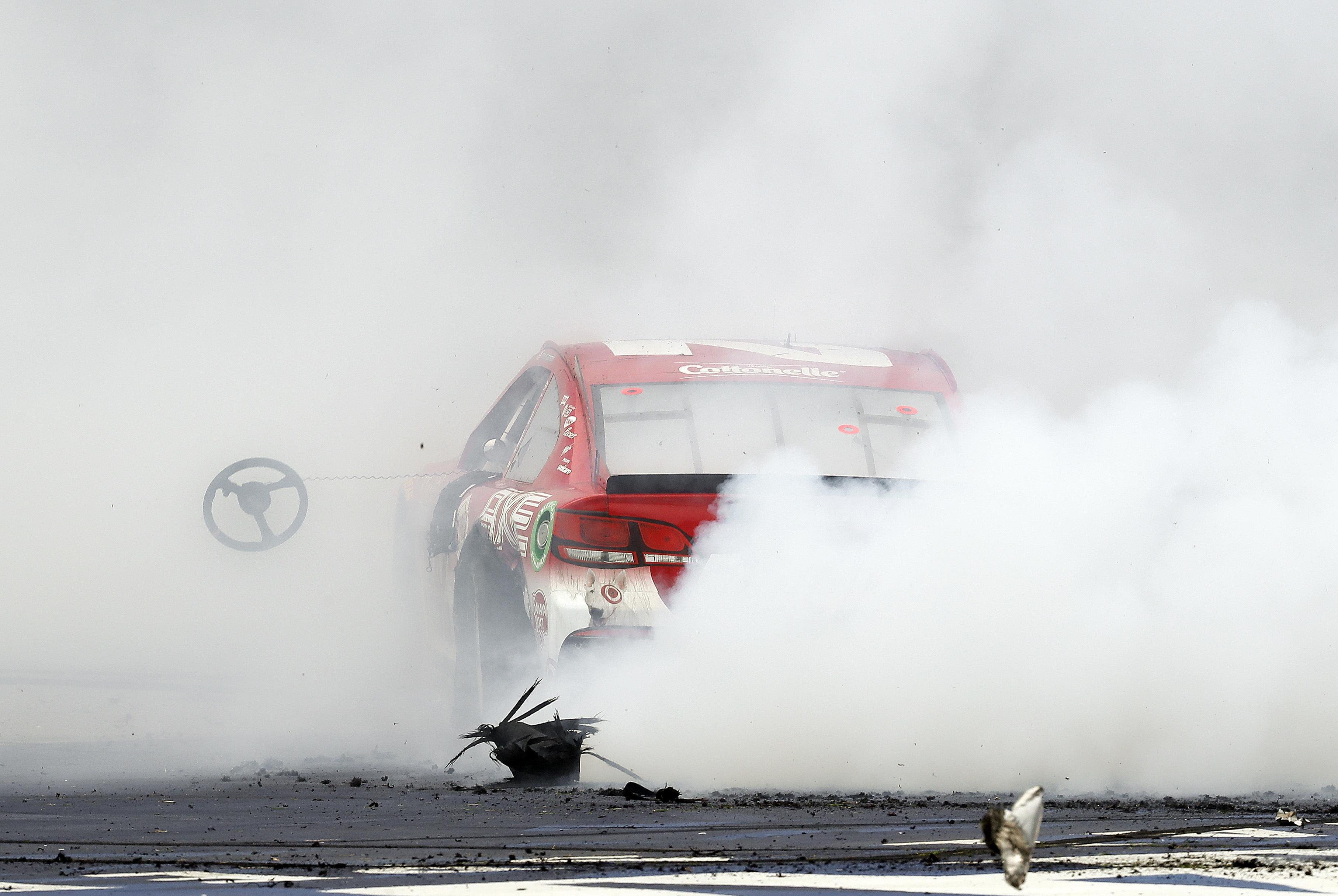 Auto racing: Kyle Larson outduels Chase Elliott for first ...