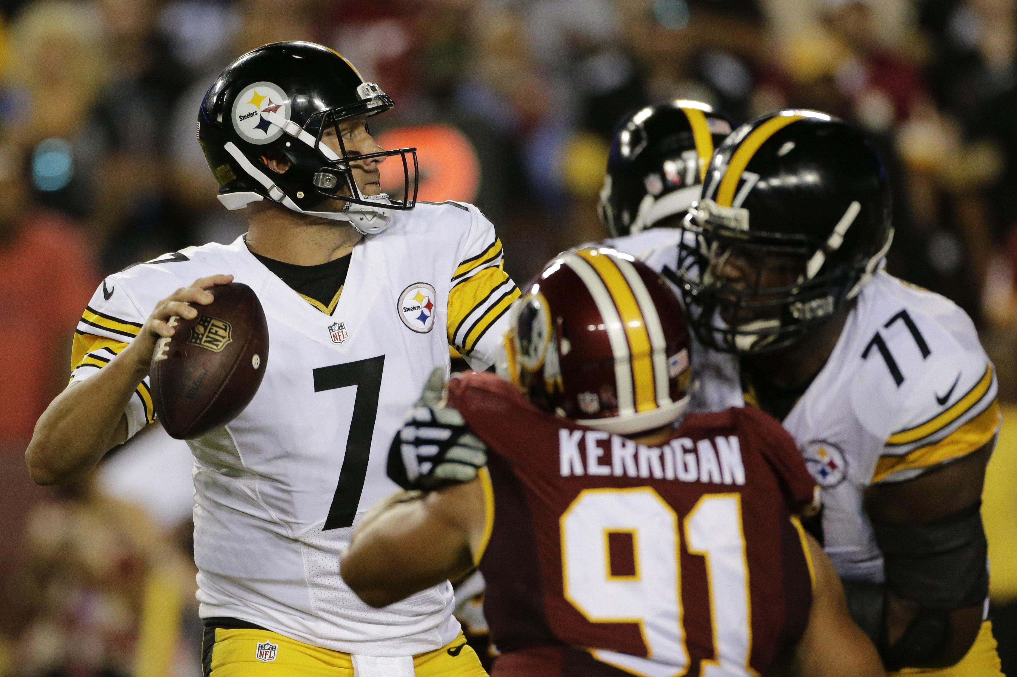 Pittsburgh Steelers Quarterback Ben Roethlisberger Looks For An Opening To Pass During The First Half Of