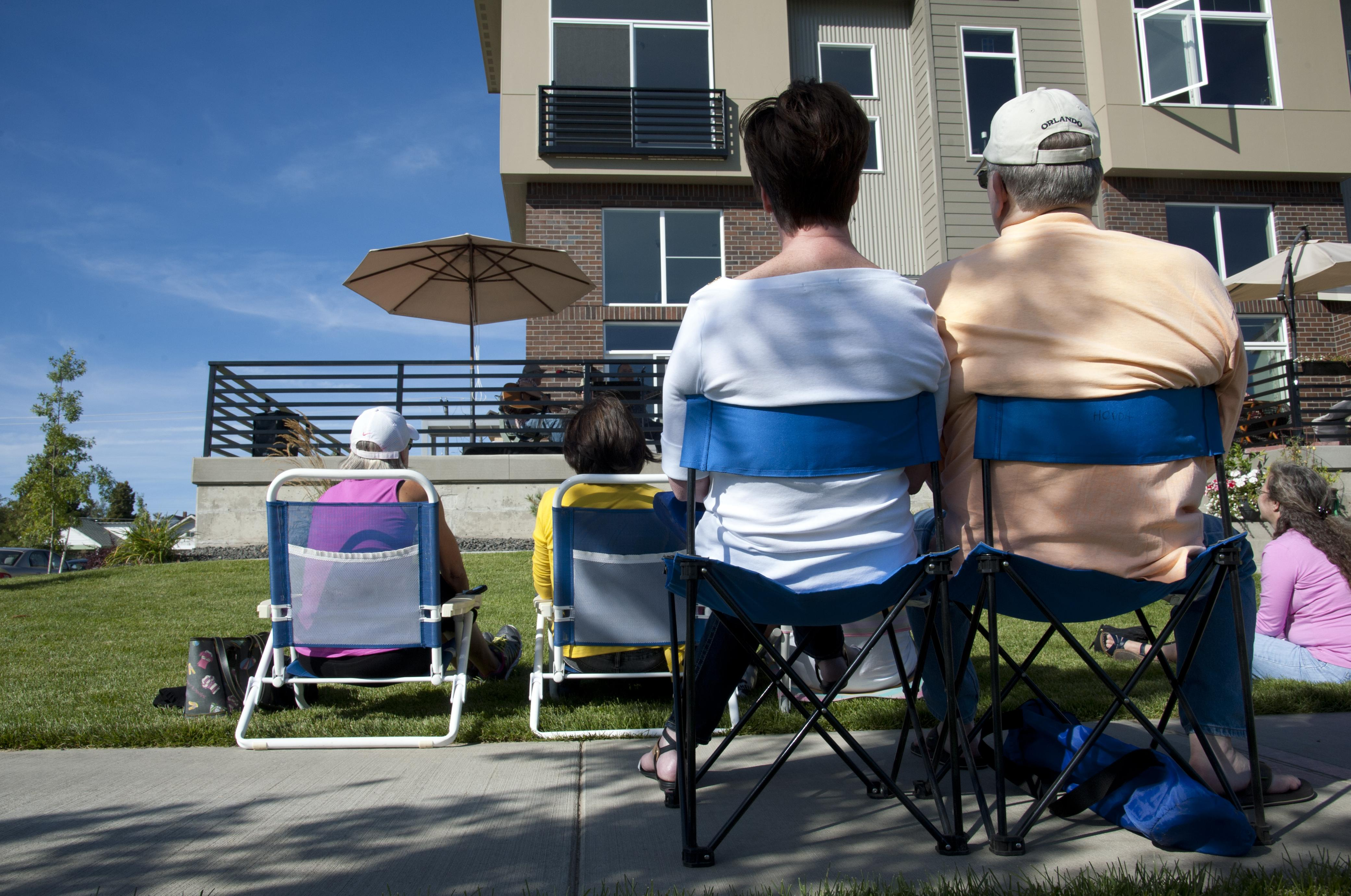 Lawn Chairs Line Summit Parkway In Kendall Yards During Porchfest 2014.  (File The Spokesman