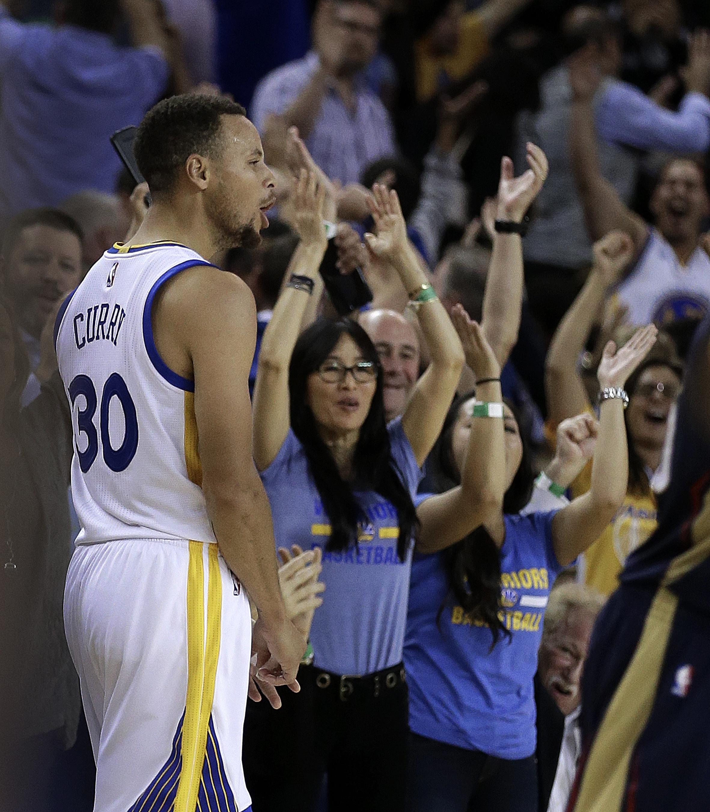 Golden State Warriors  Stephen Curry celebrates a score against the New  Orleans Pelicans during the 6fabd732e220
