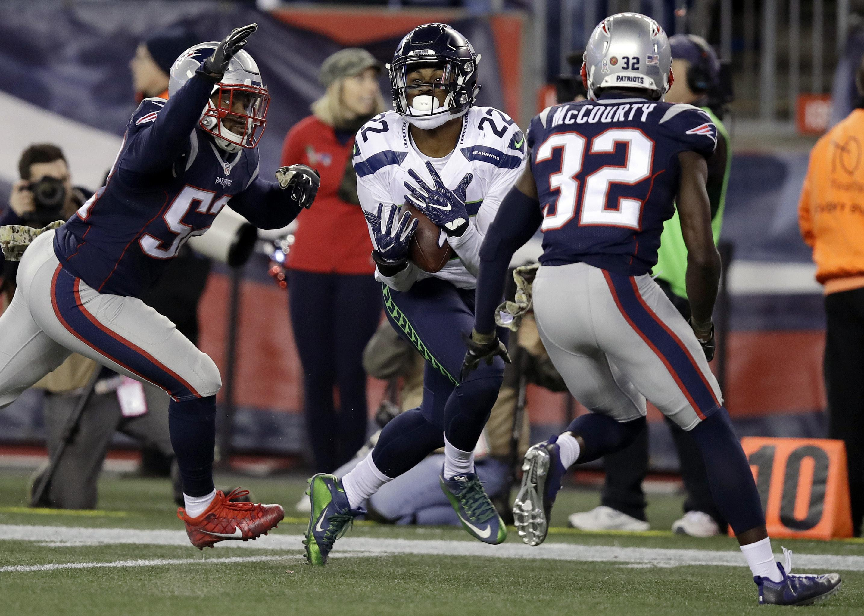 3c24b8c26 Seattle Seahawks running back C.J. Prosise (22) catches a pass between New  England Patriots
