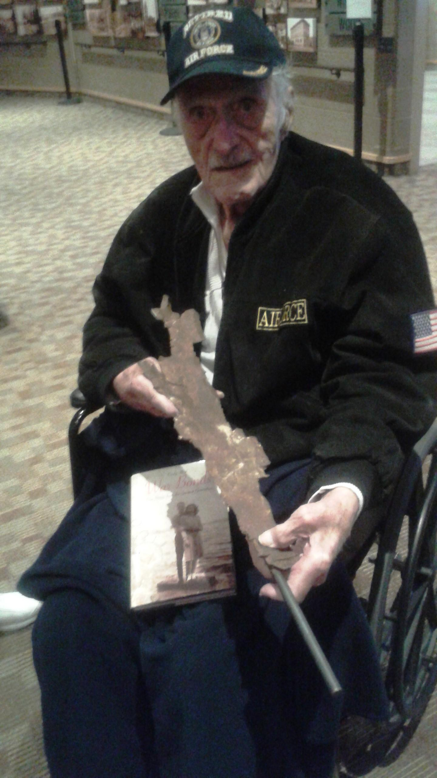 Nick Gaynos holding the piece of shrapnel that landed near him while under fire during the attack on Pearl Harbor 75 years ago. Gaynos died 20 days after this March 11, 2015, photograph. (Courtesy Cindy Hval)