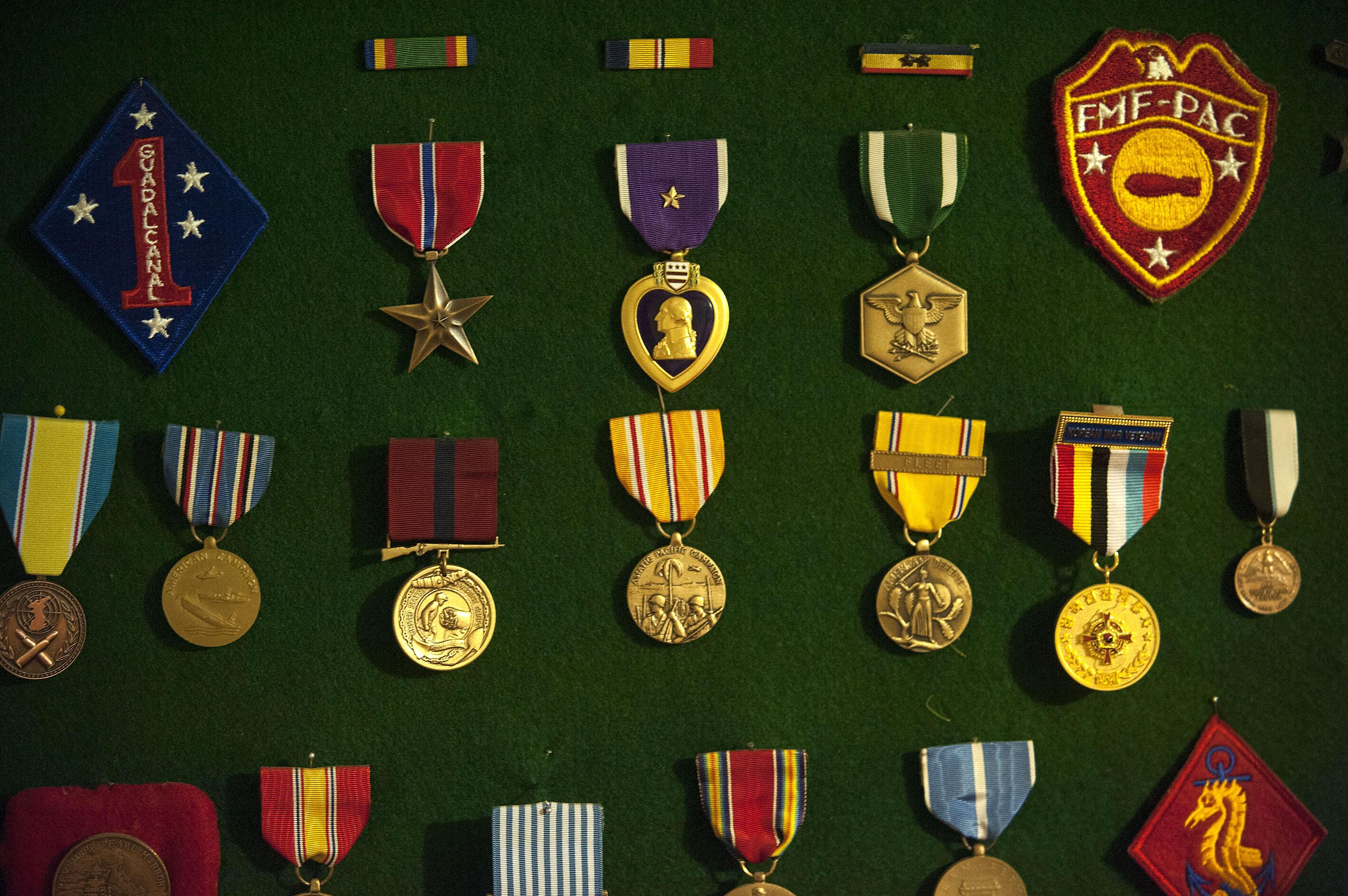 Pearl Harbor survivor Ray Garland's medals are on display in the basement of his home in Coeur d'Alene on July 8, 2016. (Kathy Plonka / The Spokesman-Review)