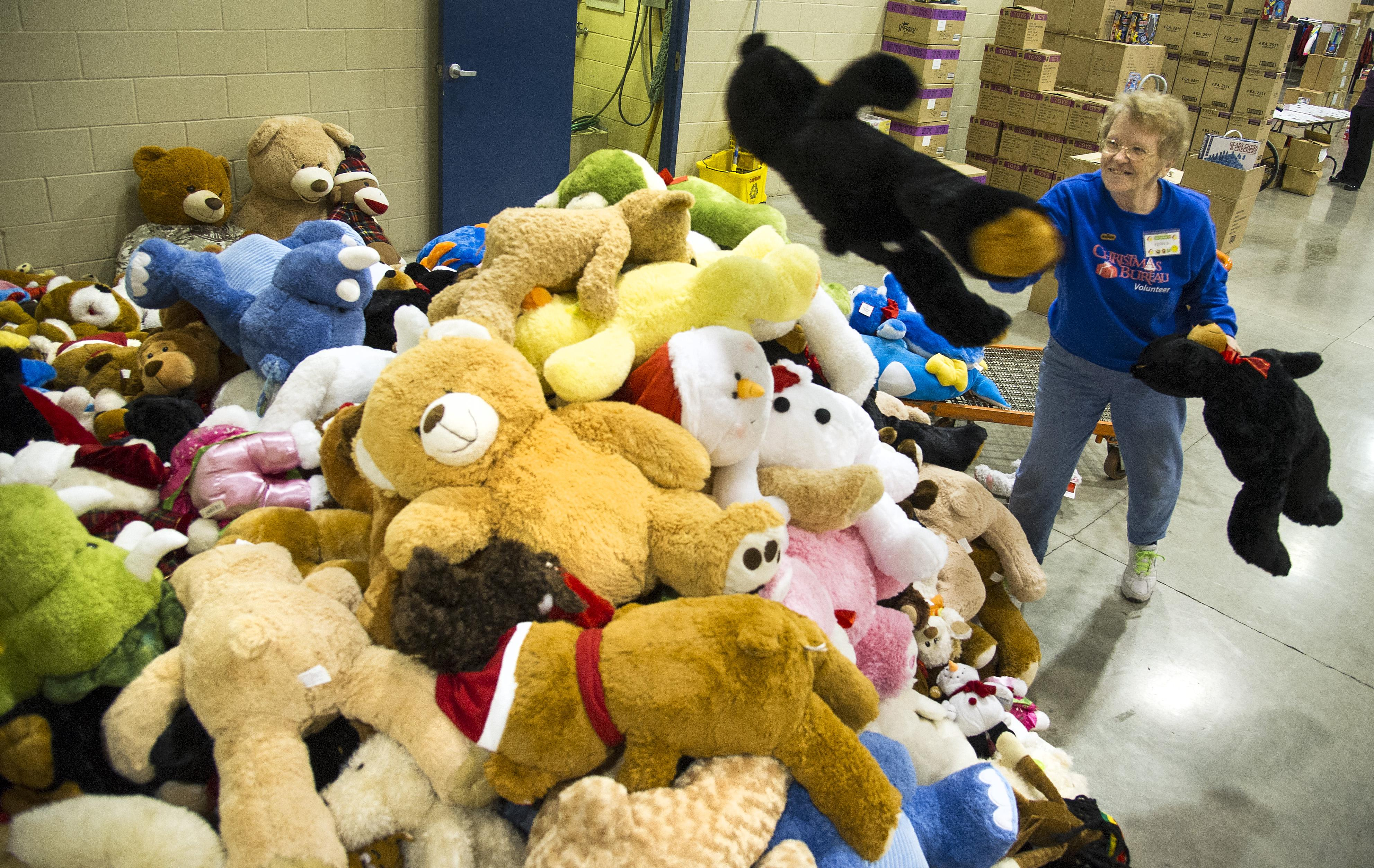 fern swecker pictured here in 2014 sorts teddy bears donated by fans at the - Best Toys Christmas 2014