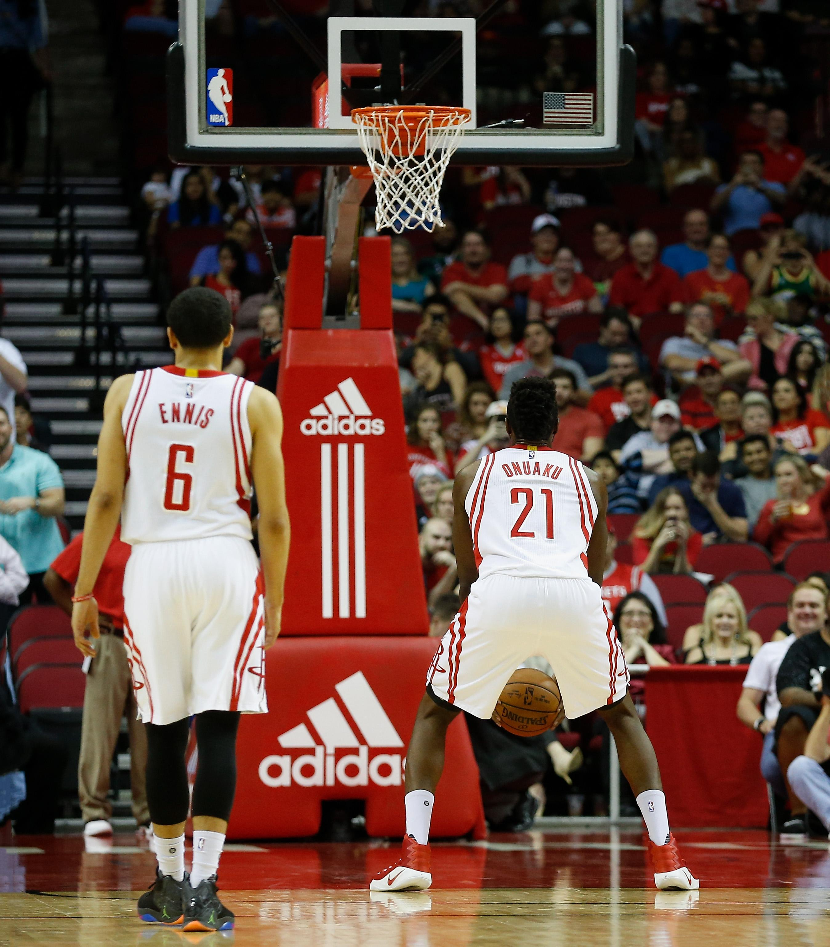 7ca87daf3873 Houston Rockets forward Chinanu Onuaku (21) shoots his free throws  underhanded as guard Tyler